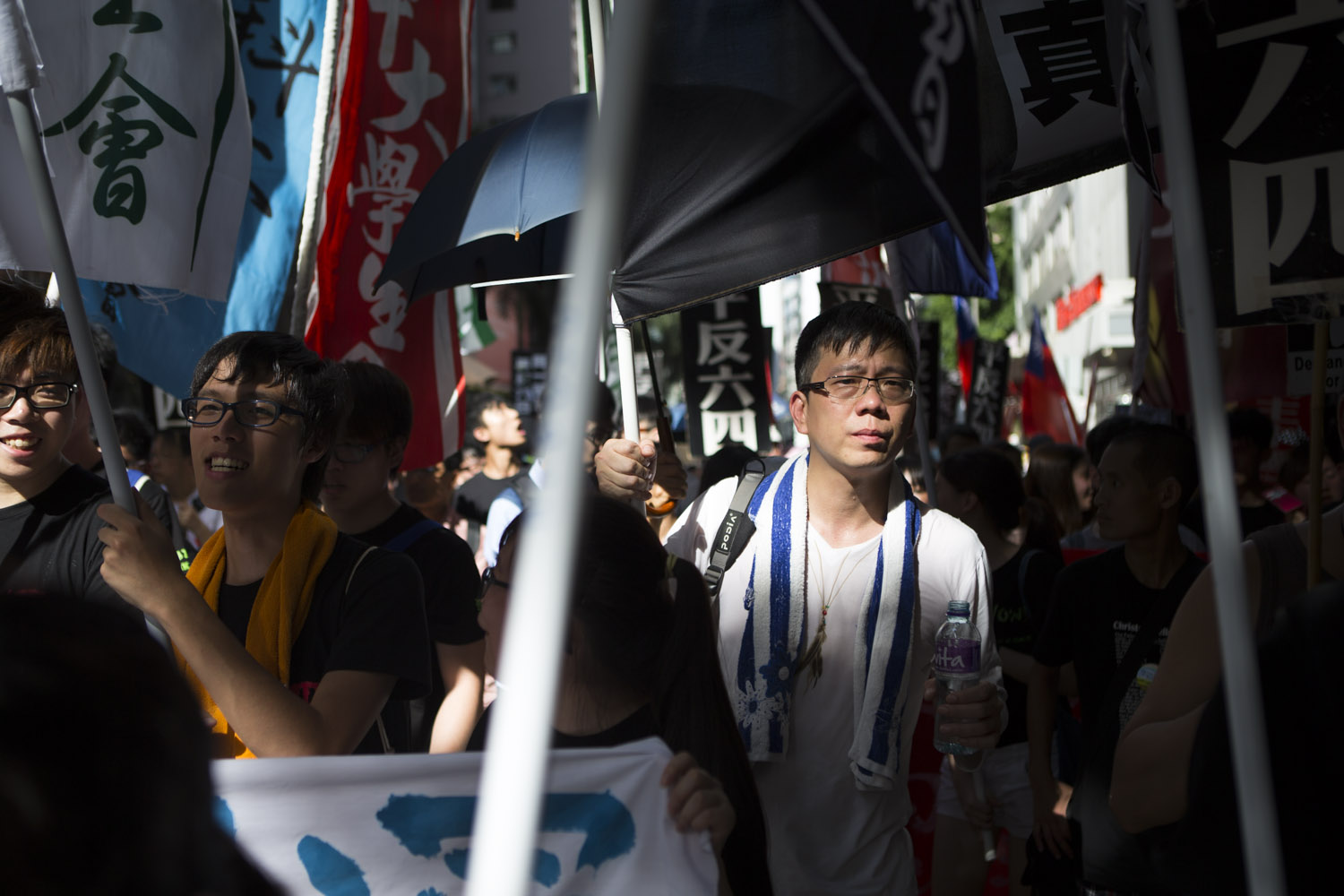 Kenneth Lam carries a sign that reads:  The truth cannot be distorted  during a pro-democracy march in Hong Kong on June 1, 2014. Lam witnessed the military crackdown in Tiananmen Square in 1989.