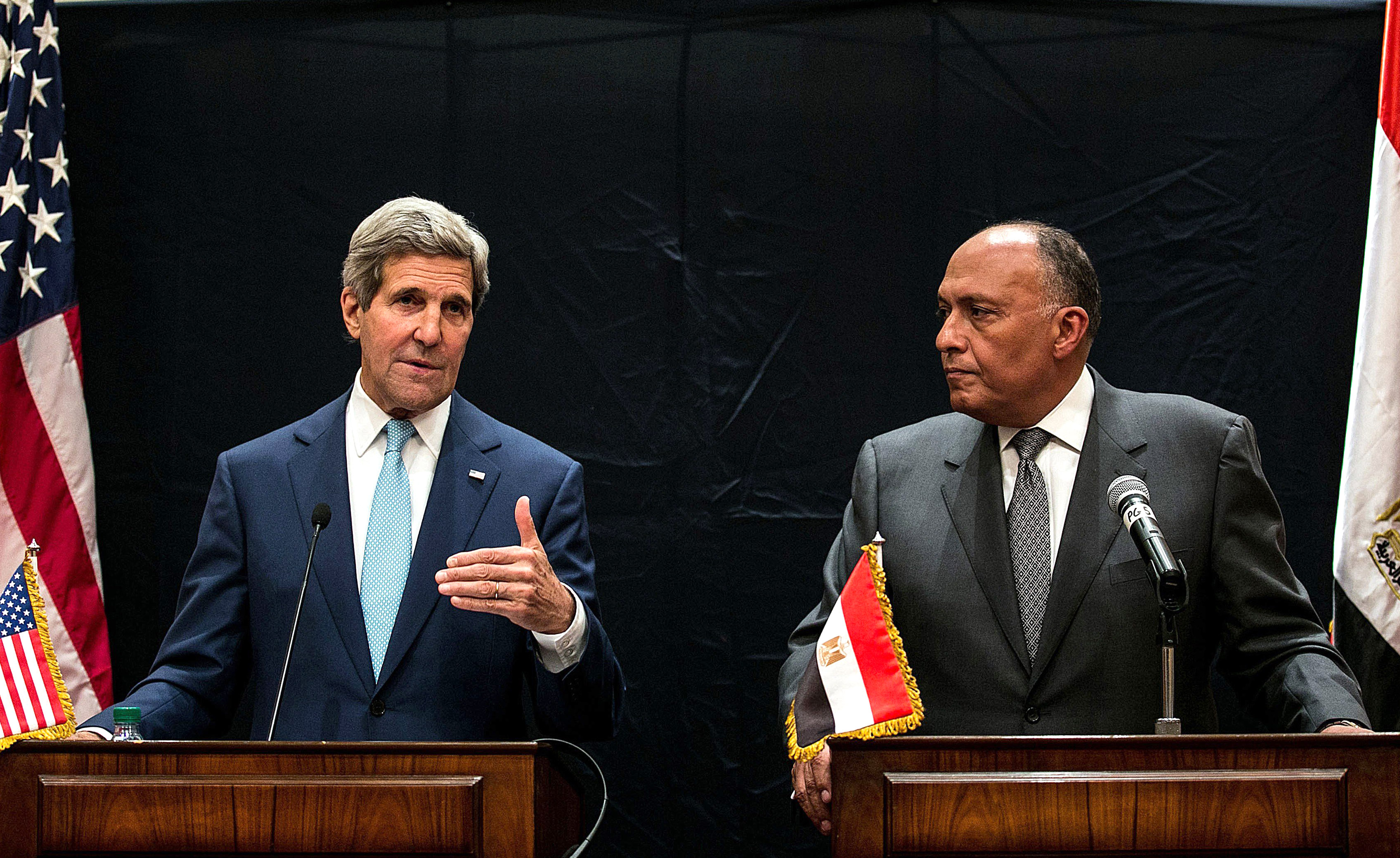 US Secretary of State John Kerry (L) and Egypt's Foreign Minister Sameh Hassan Shoukry hold a joint press conference regarding developments in Syria and Iraq on June 22, 2014 in Cairo.