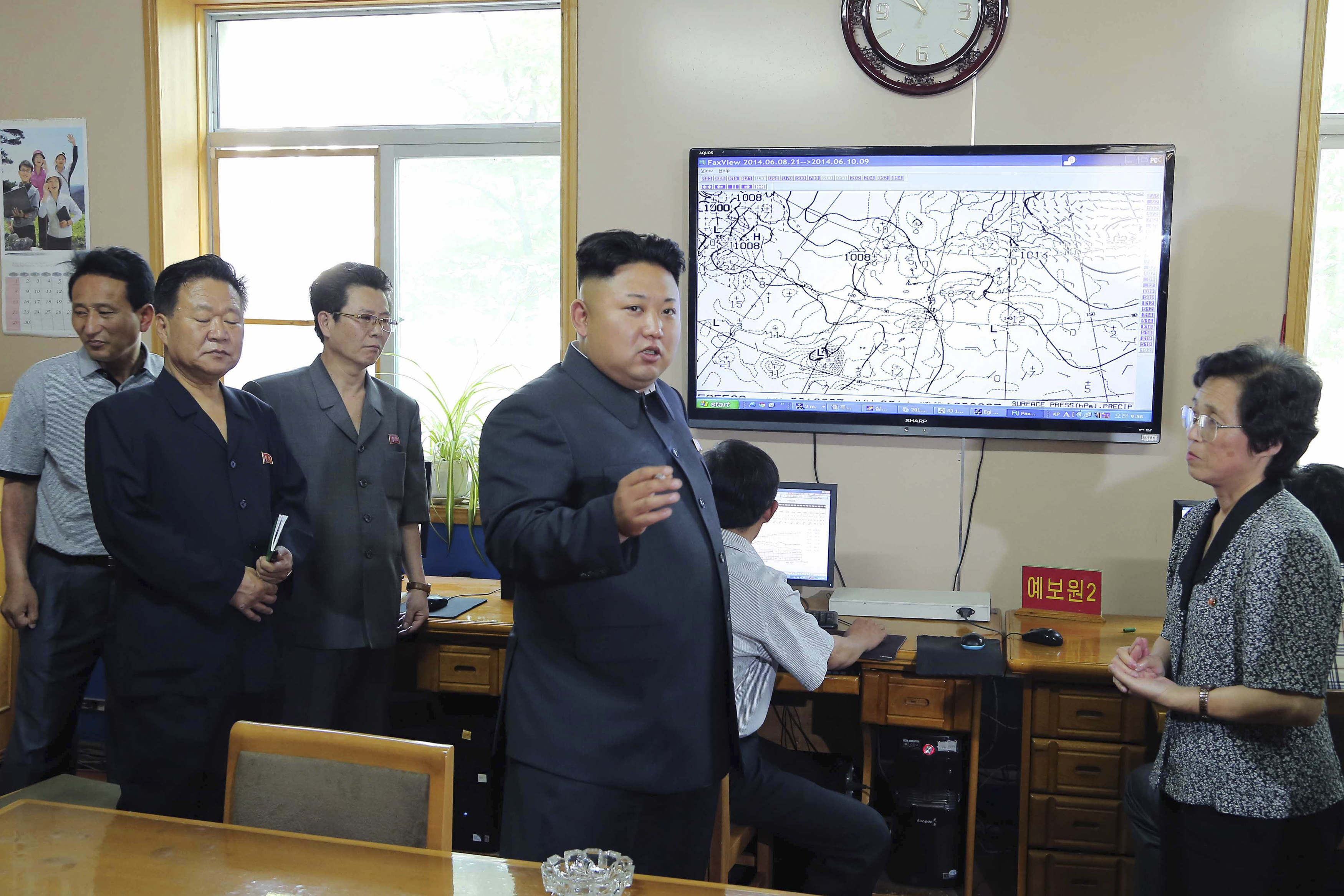 North Korean leader Kim Jong Un gives field guidance to the hydrometeorological service in this undated photo released by North Korea's Korean Central News Agency in Pyongyang on June 10, 2014