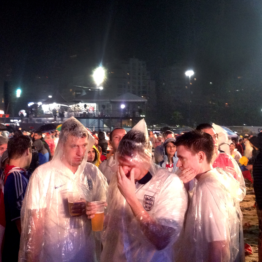 June 19, 2014. English people cry after their loss against Uruguay, at FIFA Fan Fest, under a heavy rain in Copacabana beach, Rio de Janeiro.