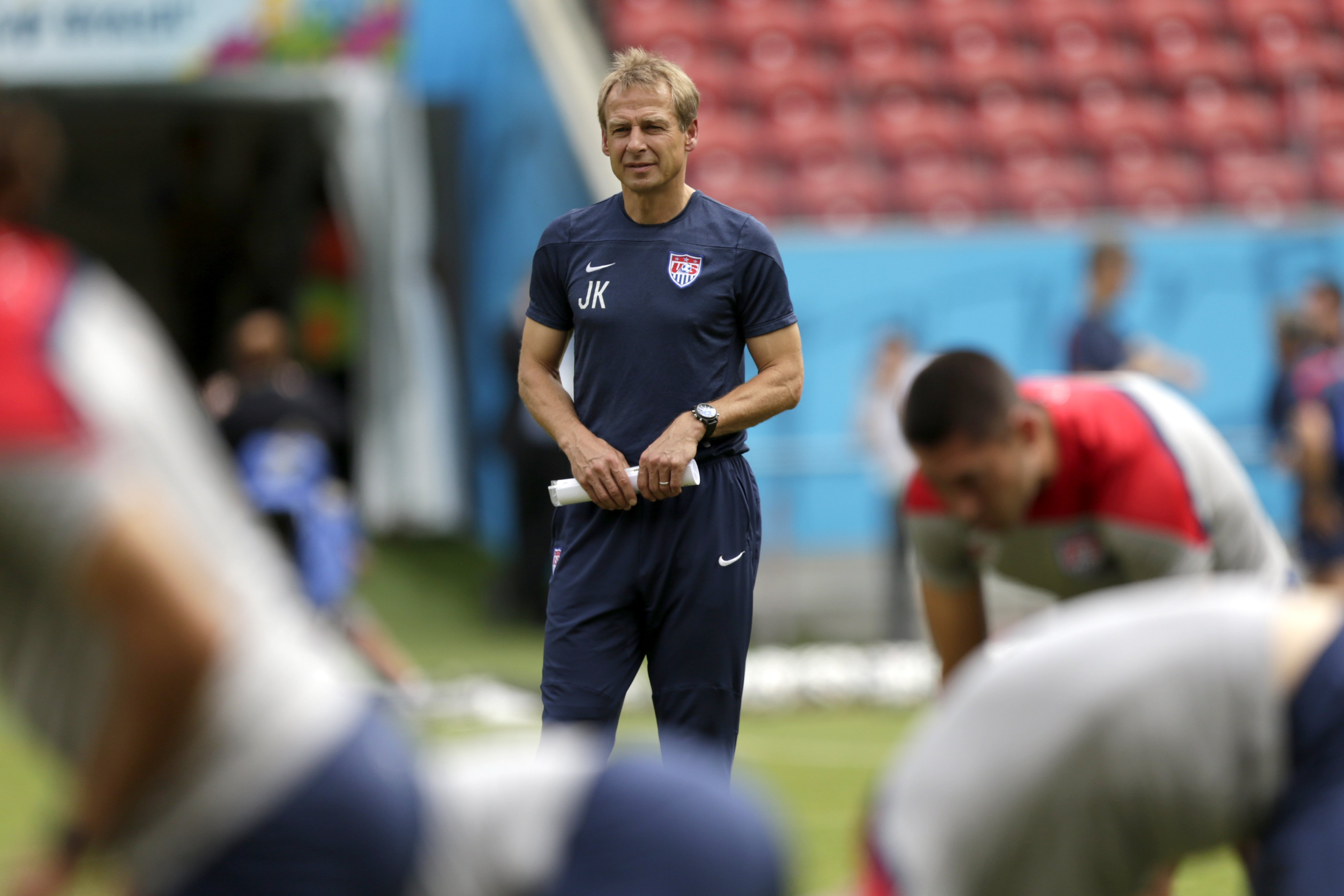 U.S. head coach Jürgen Klinsmann watches as his players stretch during a training session in Recife, Brazil, on June 25, 2014