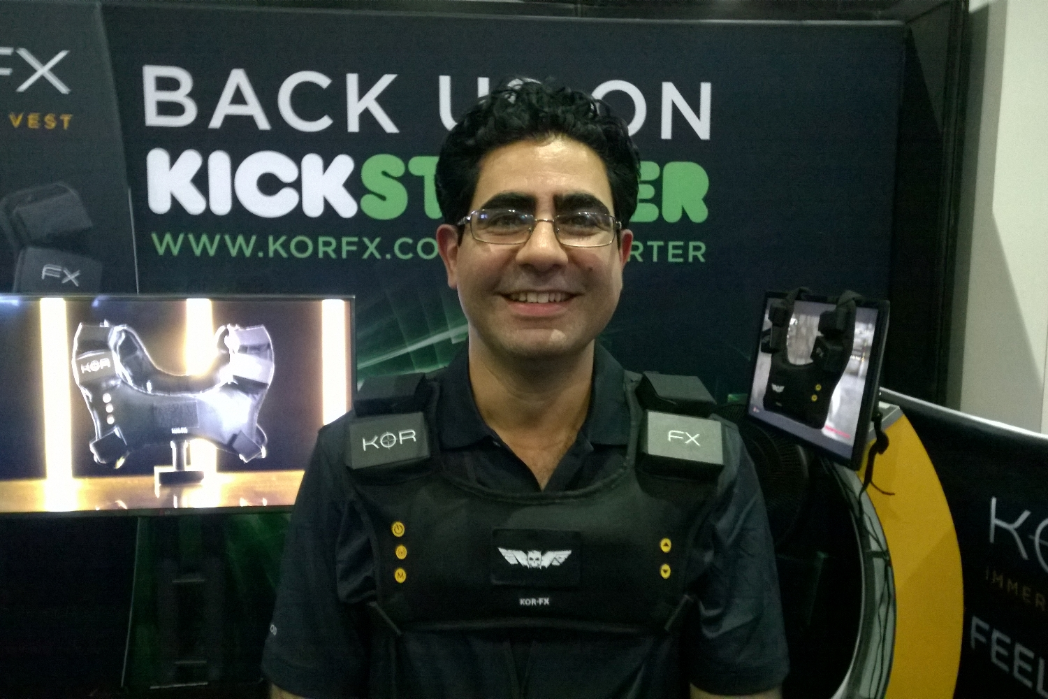 Shahriar Afshar, President and Founder of Immerz, wears the KOR-FX haptic gaming vest at E3 2014.