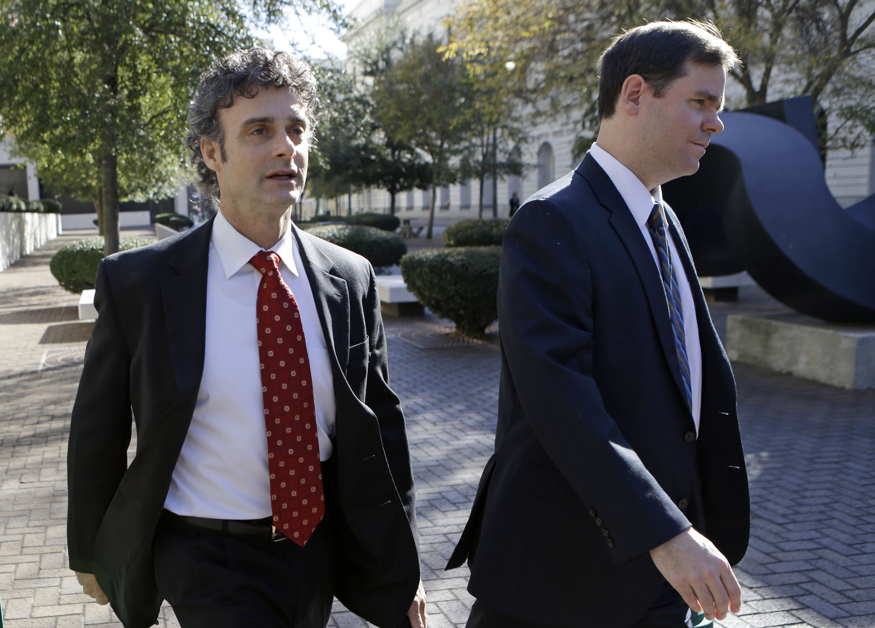 Kurt Mix, left, leaves Federal Court with an unidentified member of his defense team in New Orleans on Dec. 18, 2013.