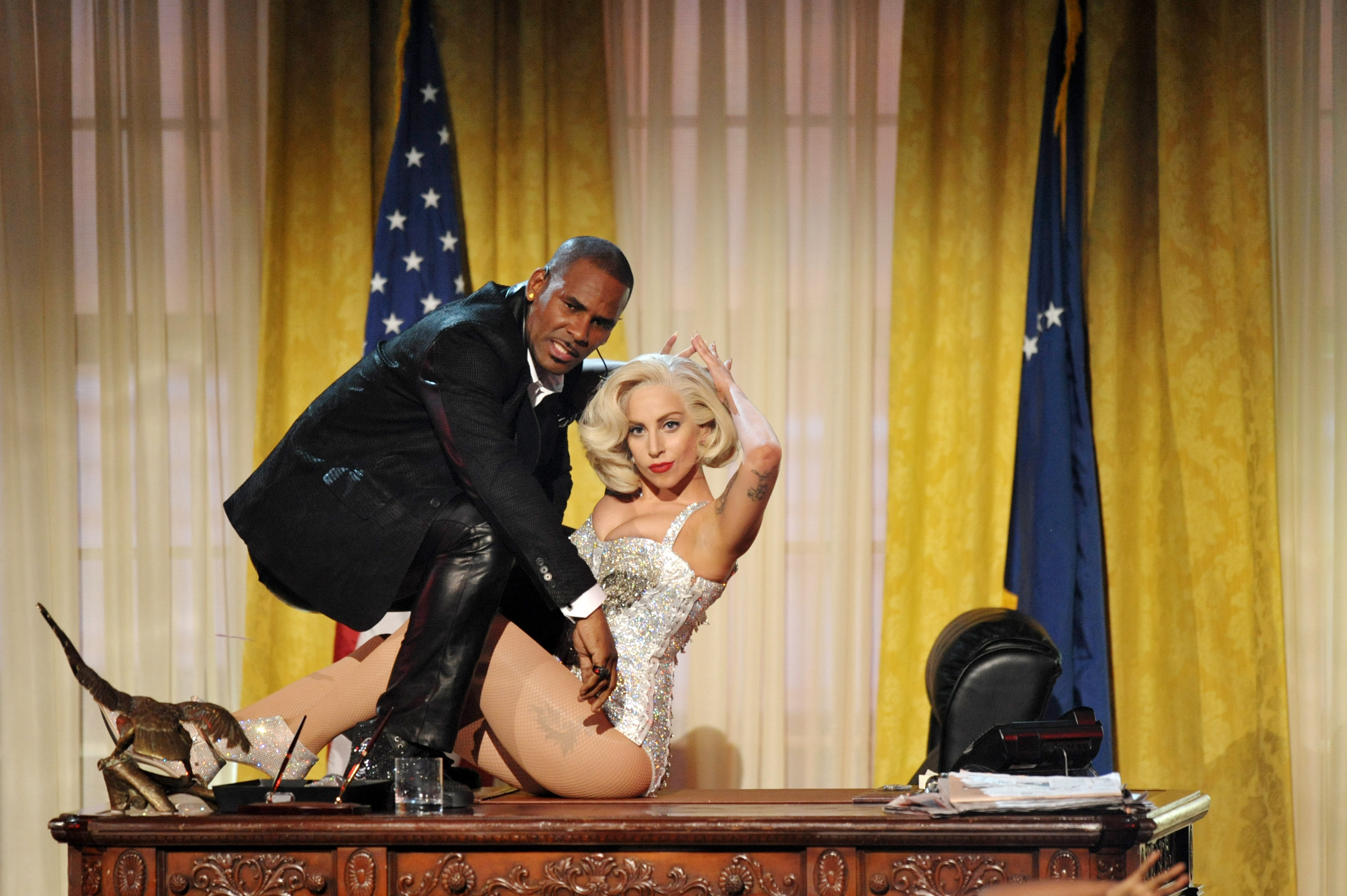 R. Kelly and Lady Gaga perform at the American Music Awards in 2013.