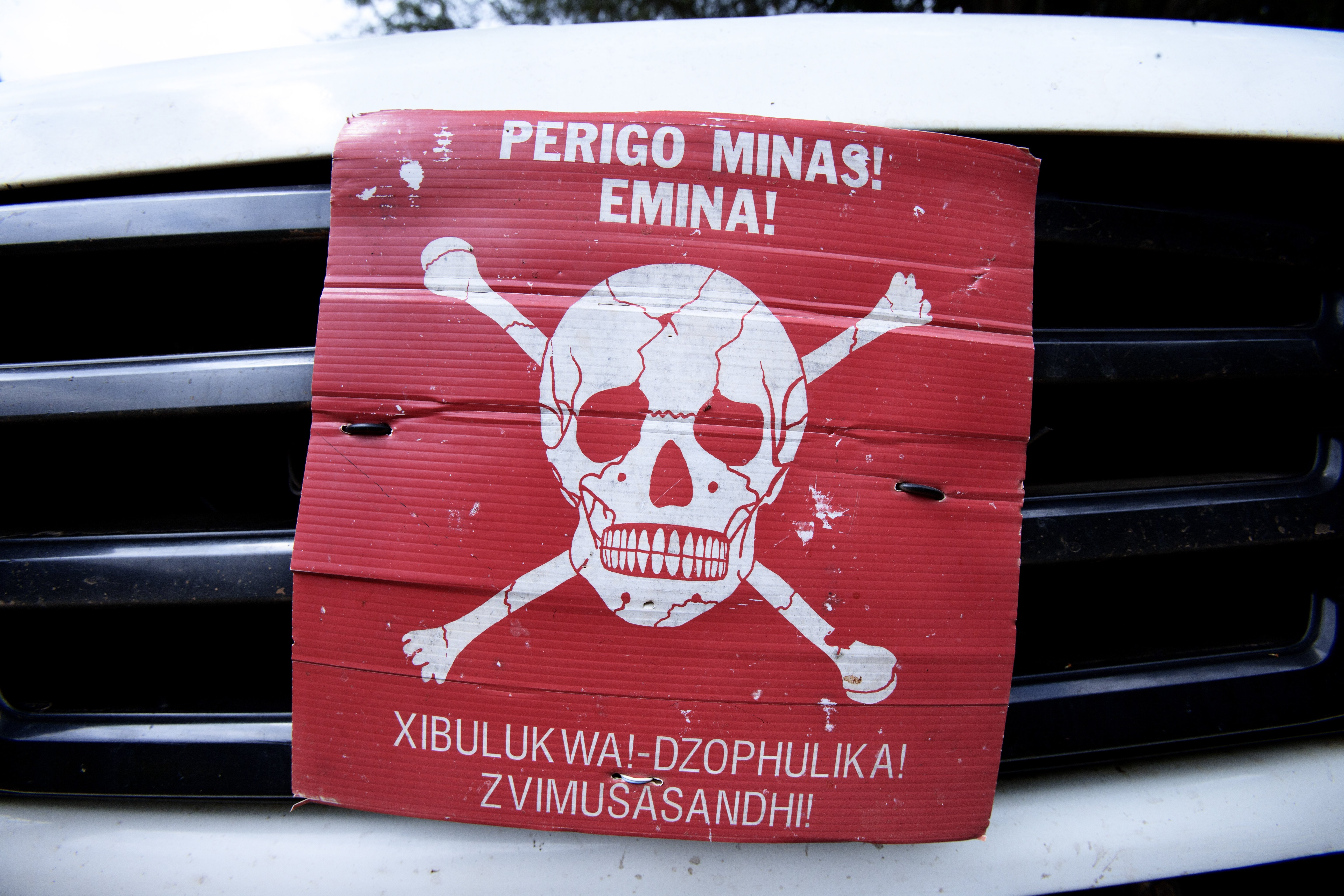 A poster announcing the danger of mines on the front of a Land Rover on June 20, 2014 in Morogoro, Tanzania.