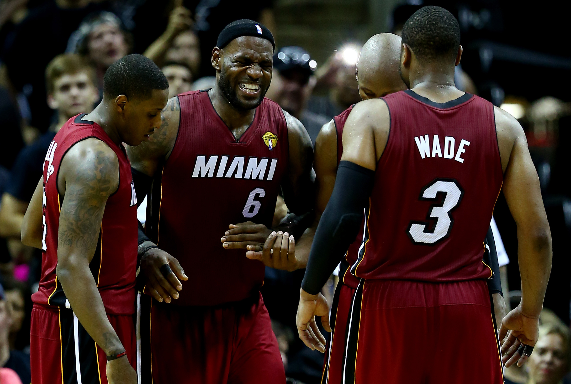 LeBron James reacts after cramping up during Game One of the 2014 NBA Finals on June 5, 2014 in San Antonio, Texas.
