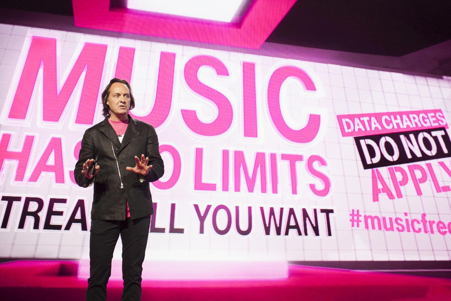 T-Mobile CEO John Legere speaks during an event in Seattle on Wednesday, June 18, 2014