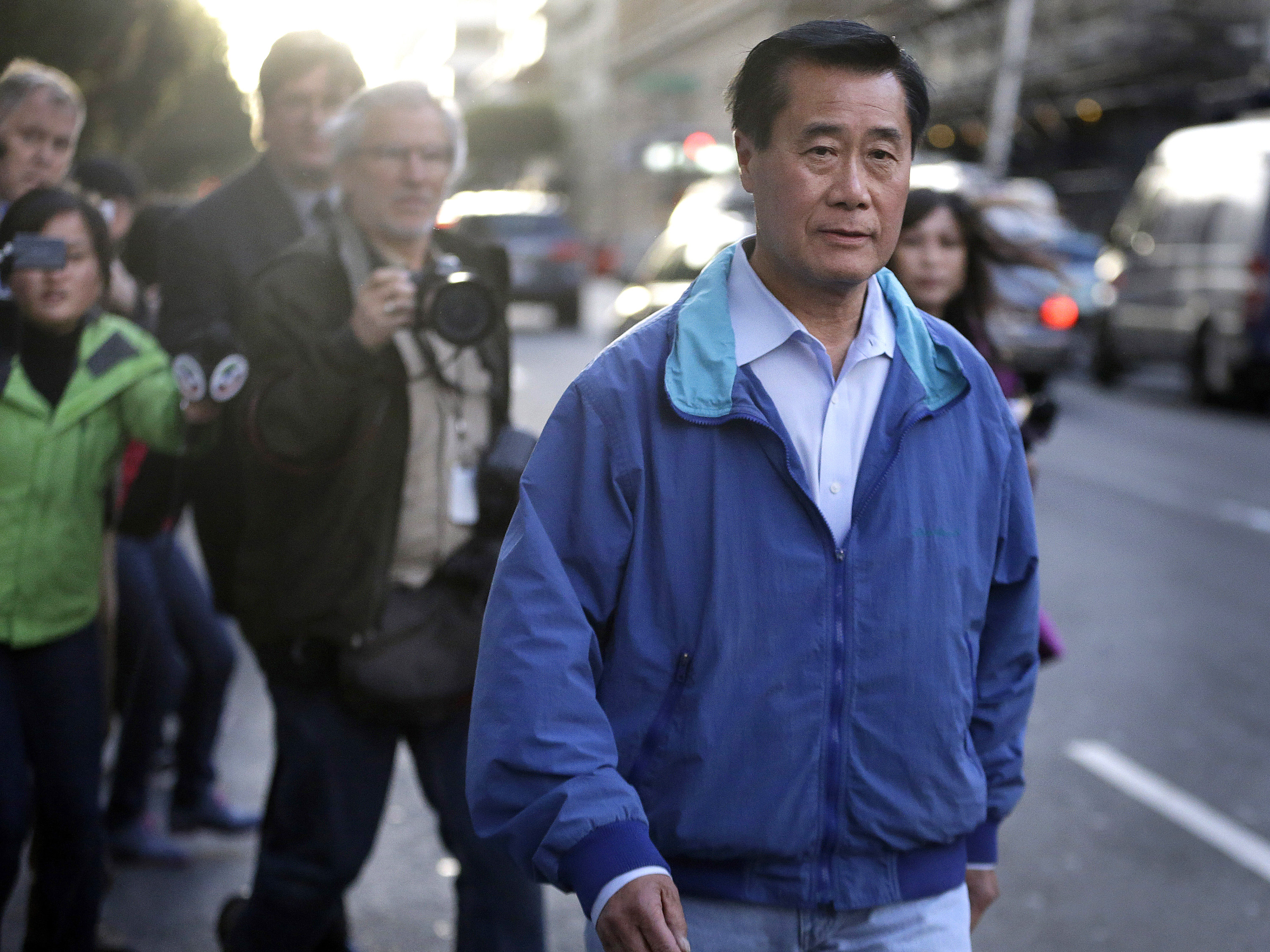 California state Sen. Leland Yee, D-San Francisco, right, leaves the San Francisco Federal Building in San Francisco, March 26, 2014.