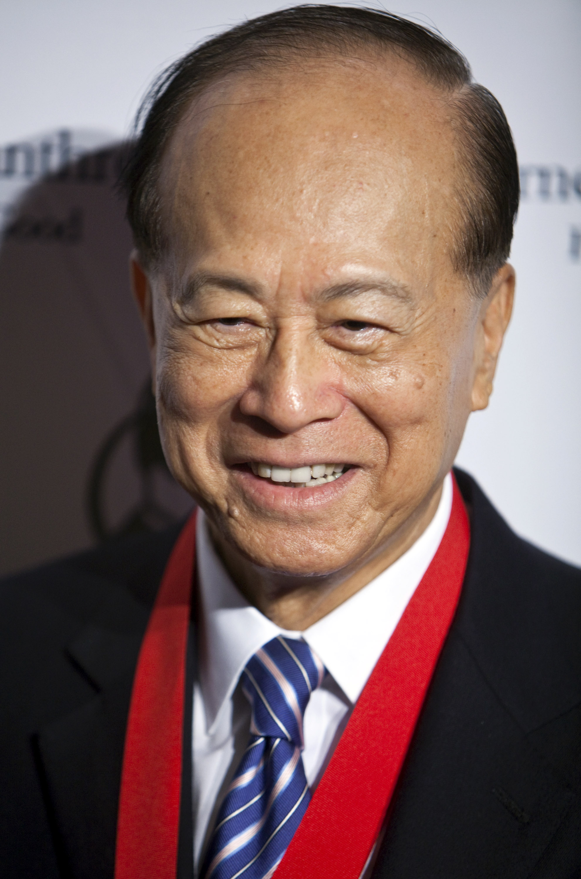 Li Ka-shing stands for a photo during the Carnegie Medal of Philanthropy award ceremony in New York on Thursday, October 20, 2011.