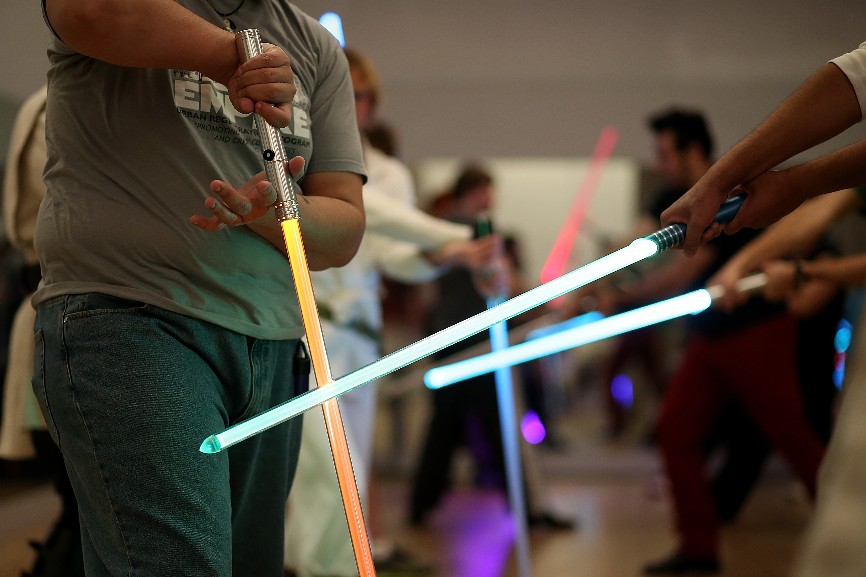 Students perform combat moves using lightsabers during a Golden Gate Knights class in saber choreography on February 24, 2013 in San Francisco.