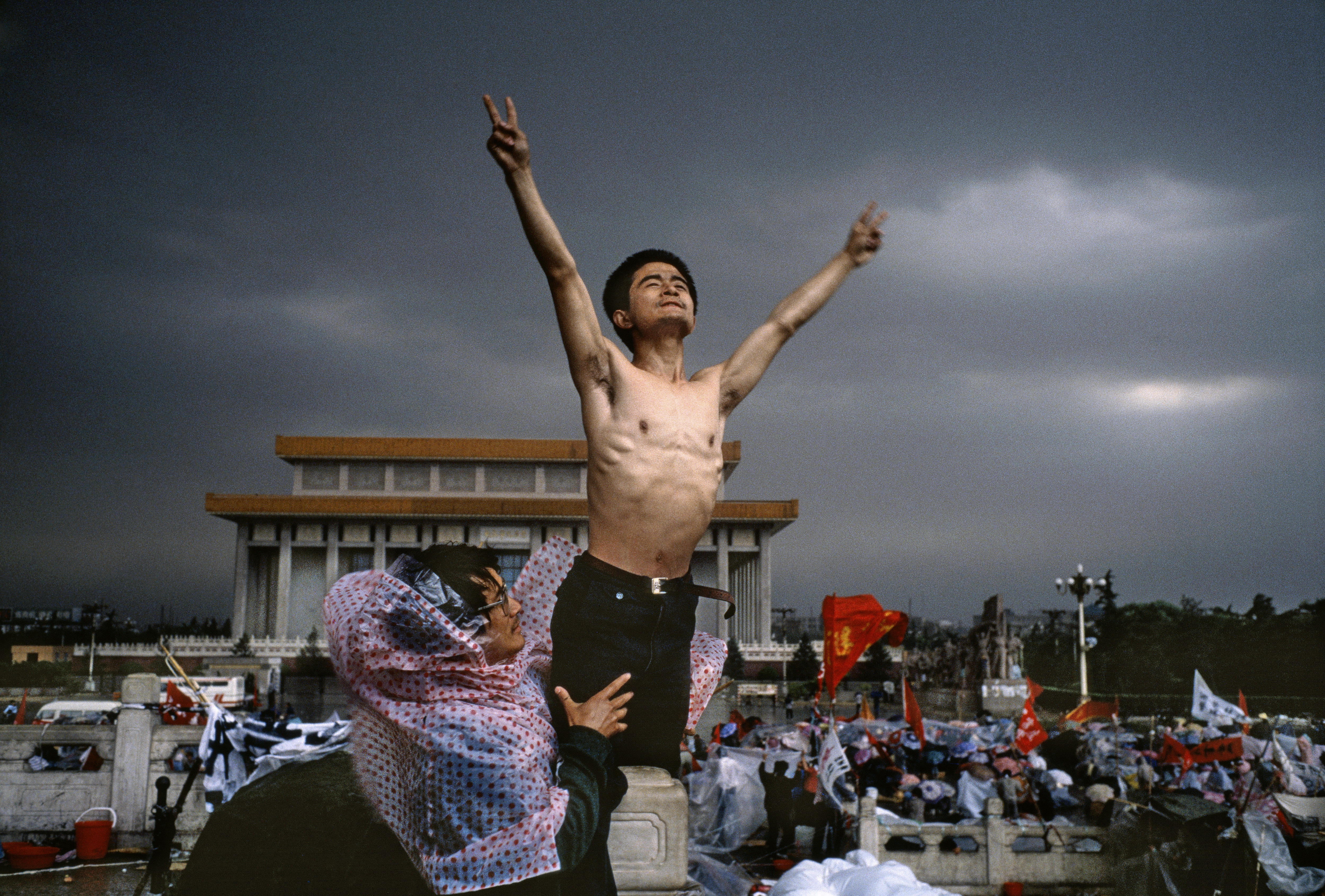 A man flashes the symbol for peace in Tiananmen Square, in Beijing, in 1989