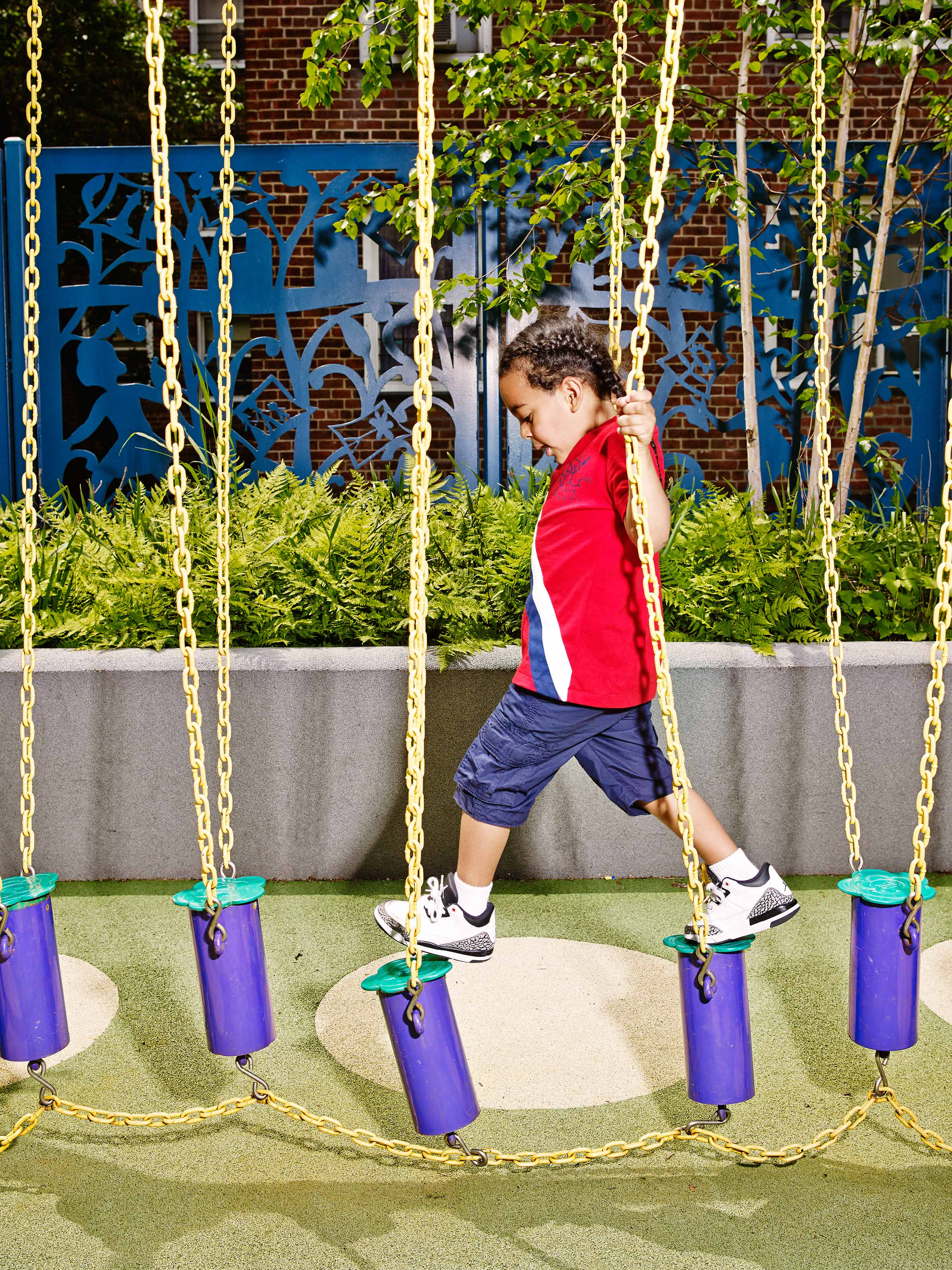 Luis Giuria's son, Xzavier, likes to play on the swing blocks, one of the playground apparatuses meant to get kids excited about exercise.