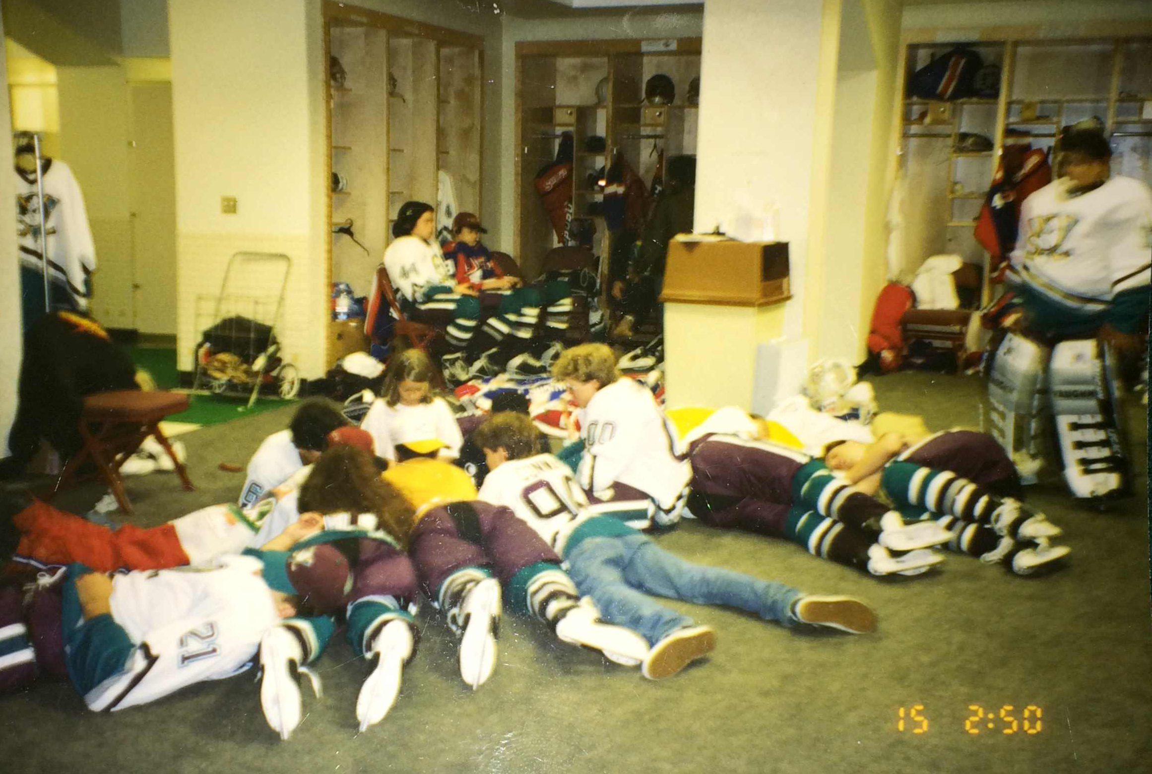 The Mighty Ducks cast hang out in the locker room.