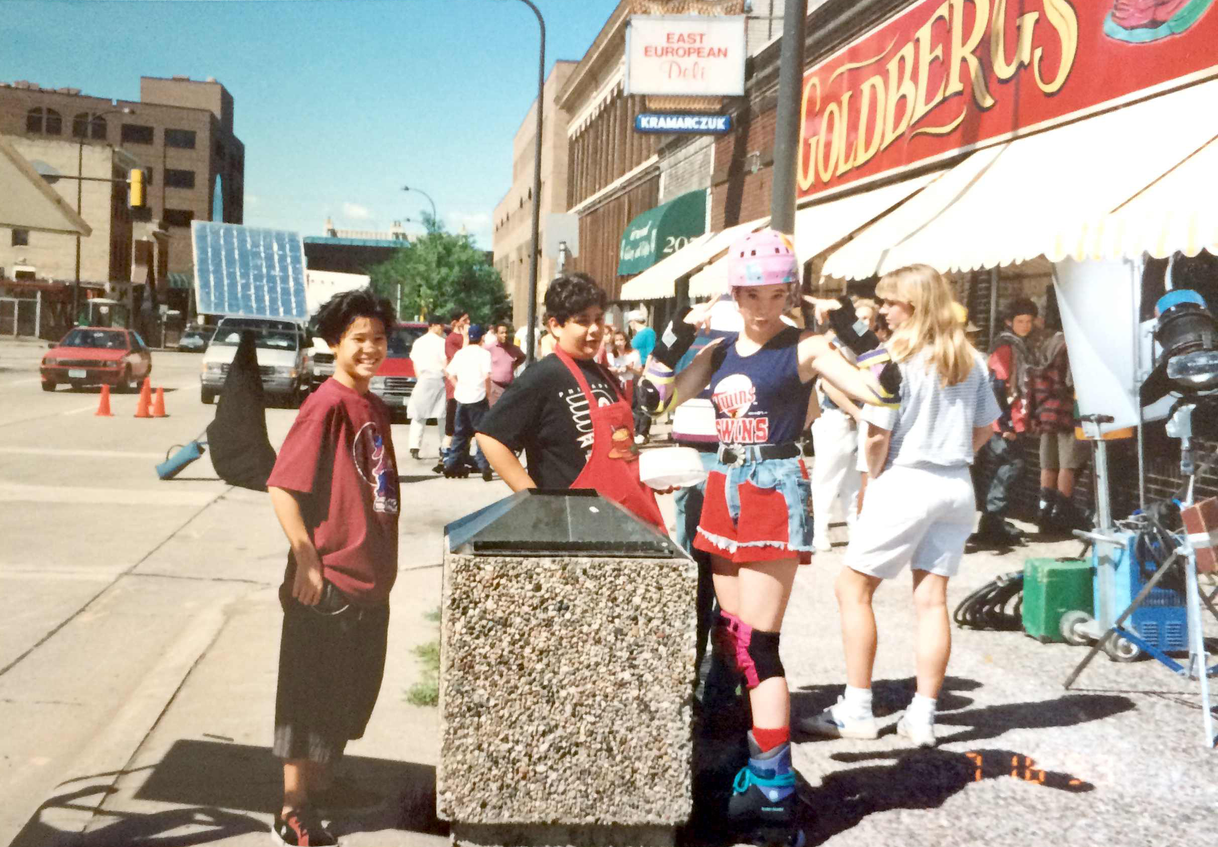 Justin Wong (Ken Wu), Shaun Weiss (Greg Goldberg) and Marguerite Moreau (Connie Moreau) on the D2: The Mighty Ducks set outside the fictional Goldberg's Deli.