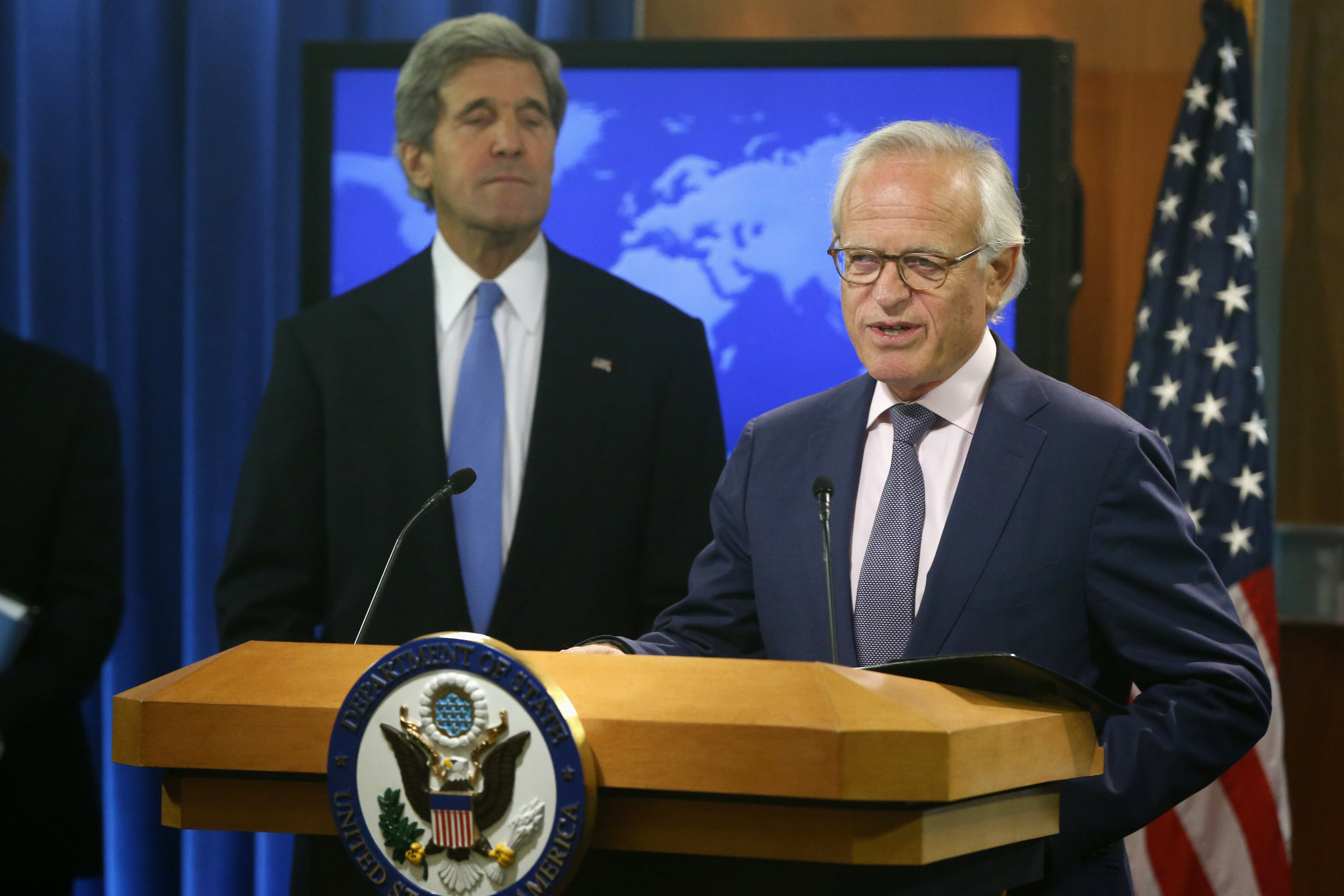Secretary of State John Kerry listening as Martin Indyk speaks at the State Department in Washington D.C. on July 29, 2013.