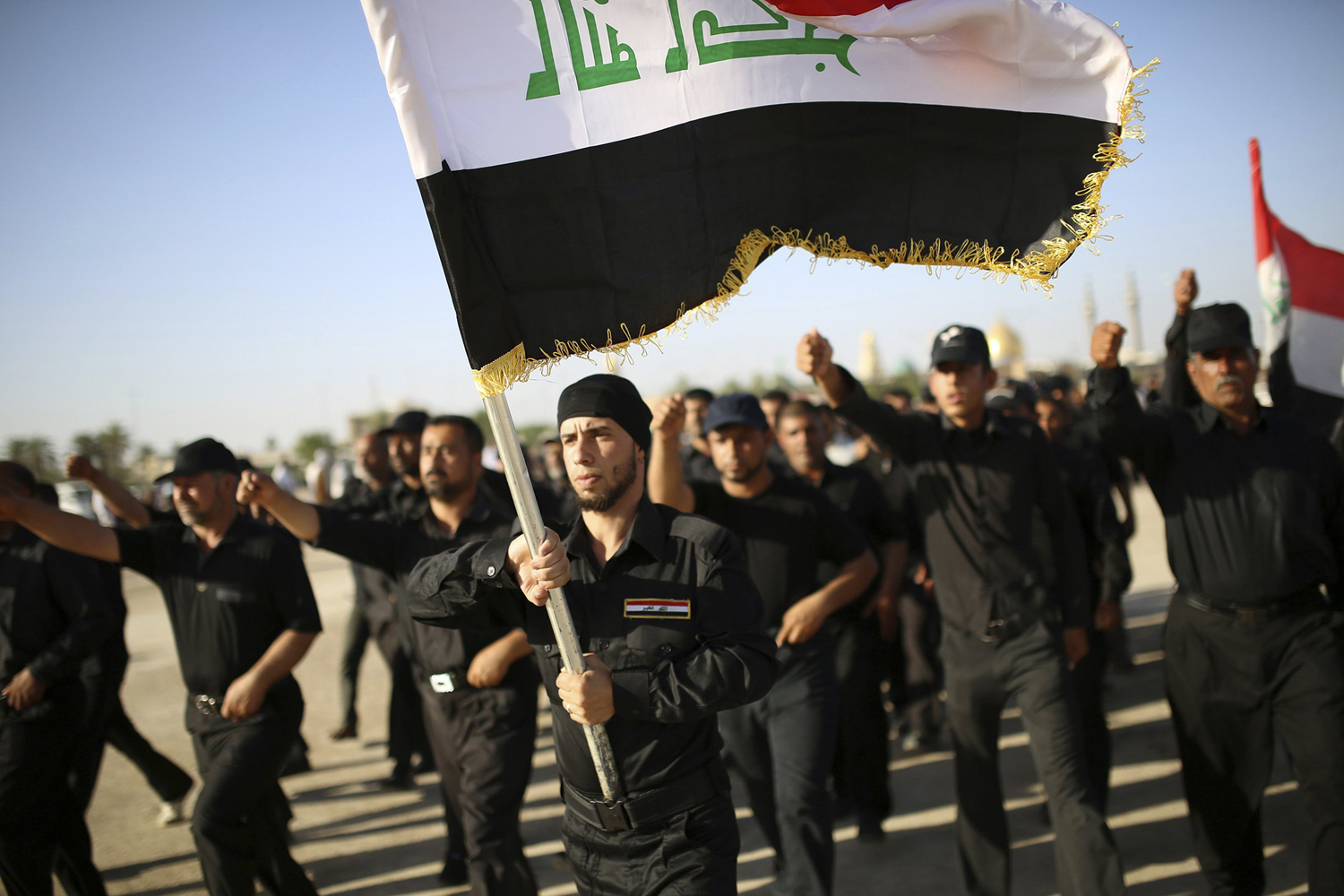Mehdi Army fighters loyal to Shiite cleric Moqtada al-Sadr march during a military-style training in the holy city of Najaf, June 17.