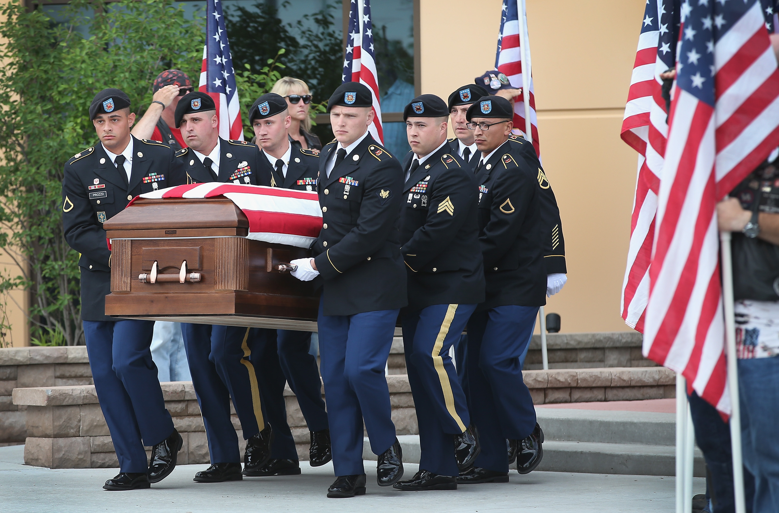 Soldiers carry the casket of U.S. Army Pfc. Aaron Toppen from Parkview Christian Church following his funeral service on June 24, 2014 in Mokena, Ill.