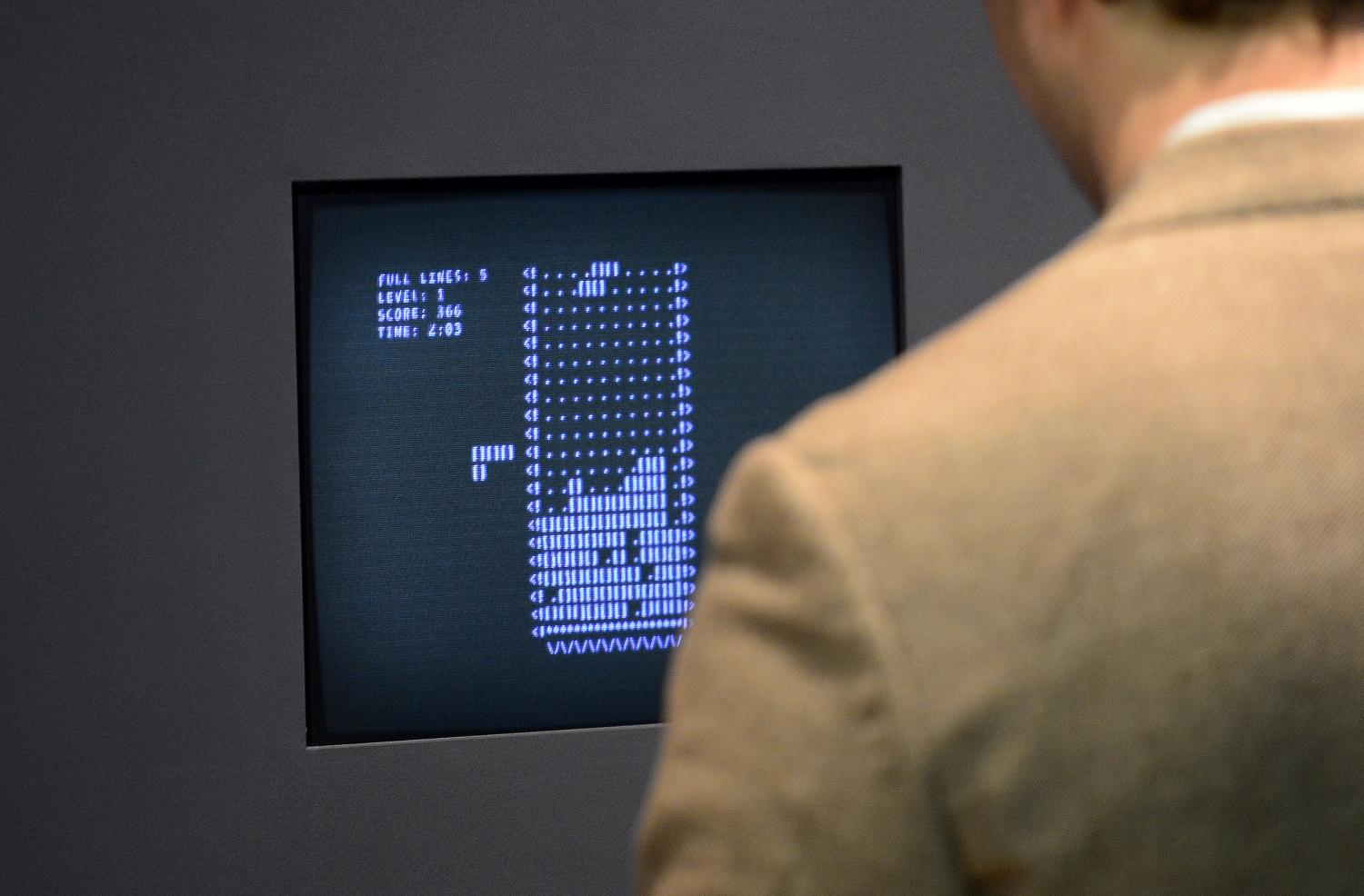 A visitor plays Tetris during an exhibition preview featuring 14 video games acquired by The Museum of Modern Art (MoMA) in New York, March 1, 2013