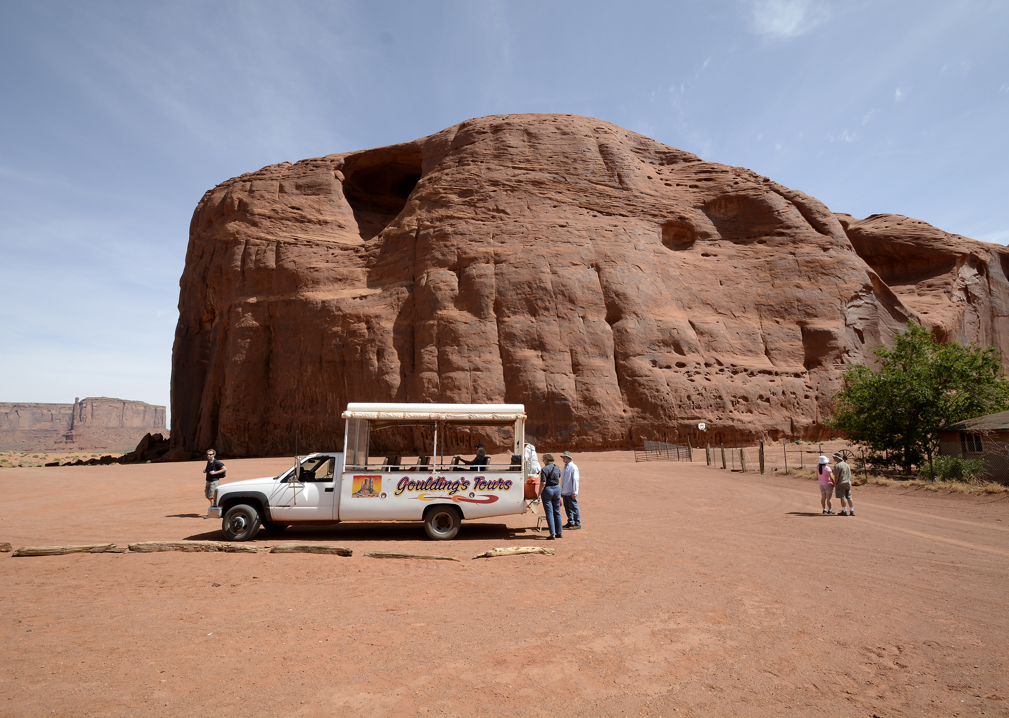 Tourists in specially designed vehicles enjoy the view on a tour of Monument Valley Navajo Tribal Park in southeastern Utah, May 16, 2014.