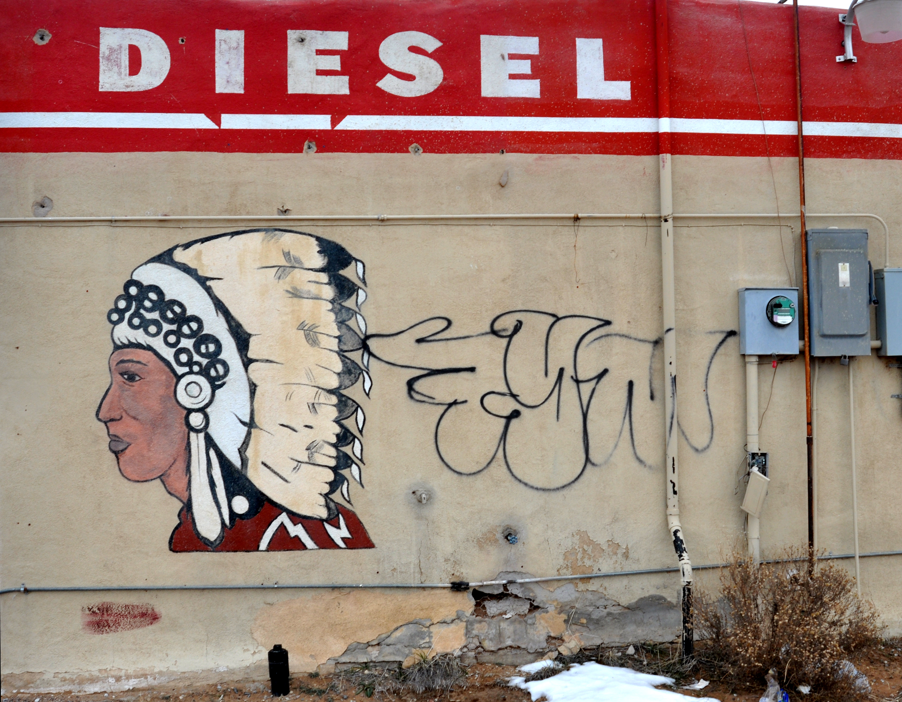 A painting of a Native American chief wearing a Plains Indian headdress adorns the abandoned Big Chief gas station on the Zia Pueblo in northern New Mexico, Dec. 2012.