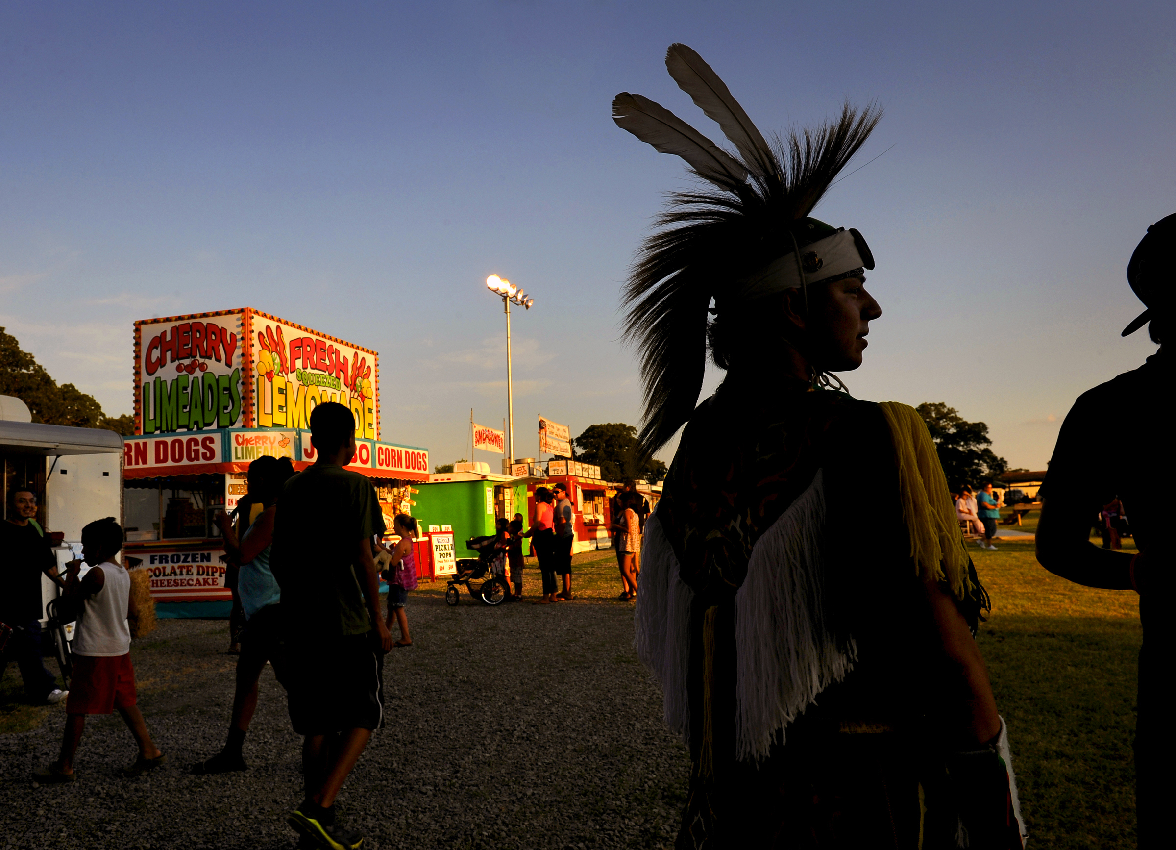 Kaylon Wood, 15, waits for a tribal ceremony to begin as he was taking part in a Pow Wow at the Sac and Fox Nation annual event in Stroud, Okla. on July 30, 2012.