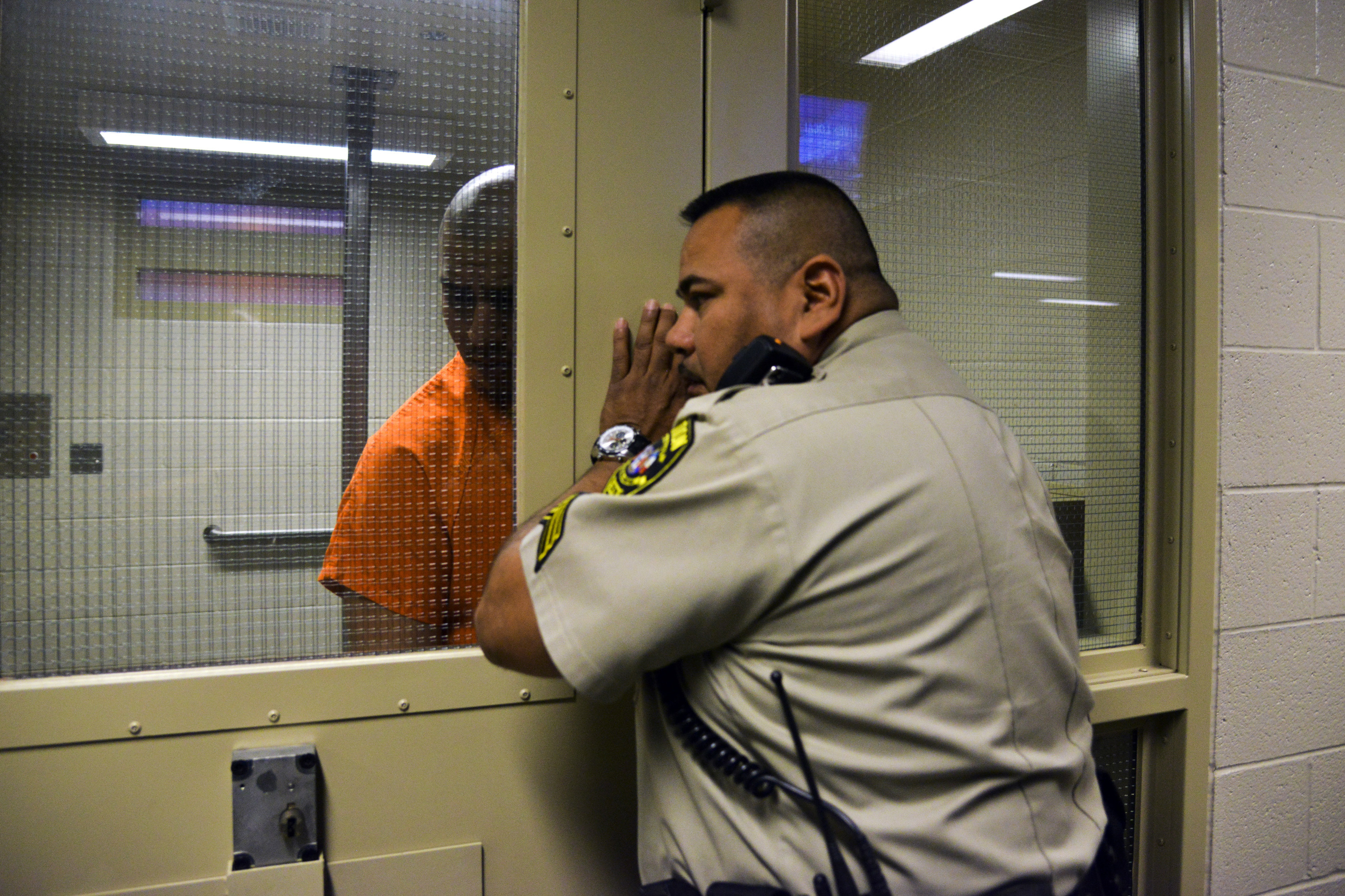 Officer Jesse Hernandez talks to a prisoner in the Pascua Yaqui tribal jail in the Pascua Yaqui Indian Reservation, Ariz. on March 18, 2014.