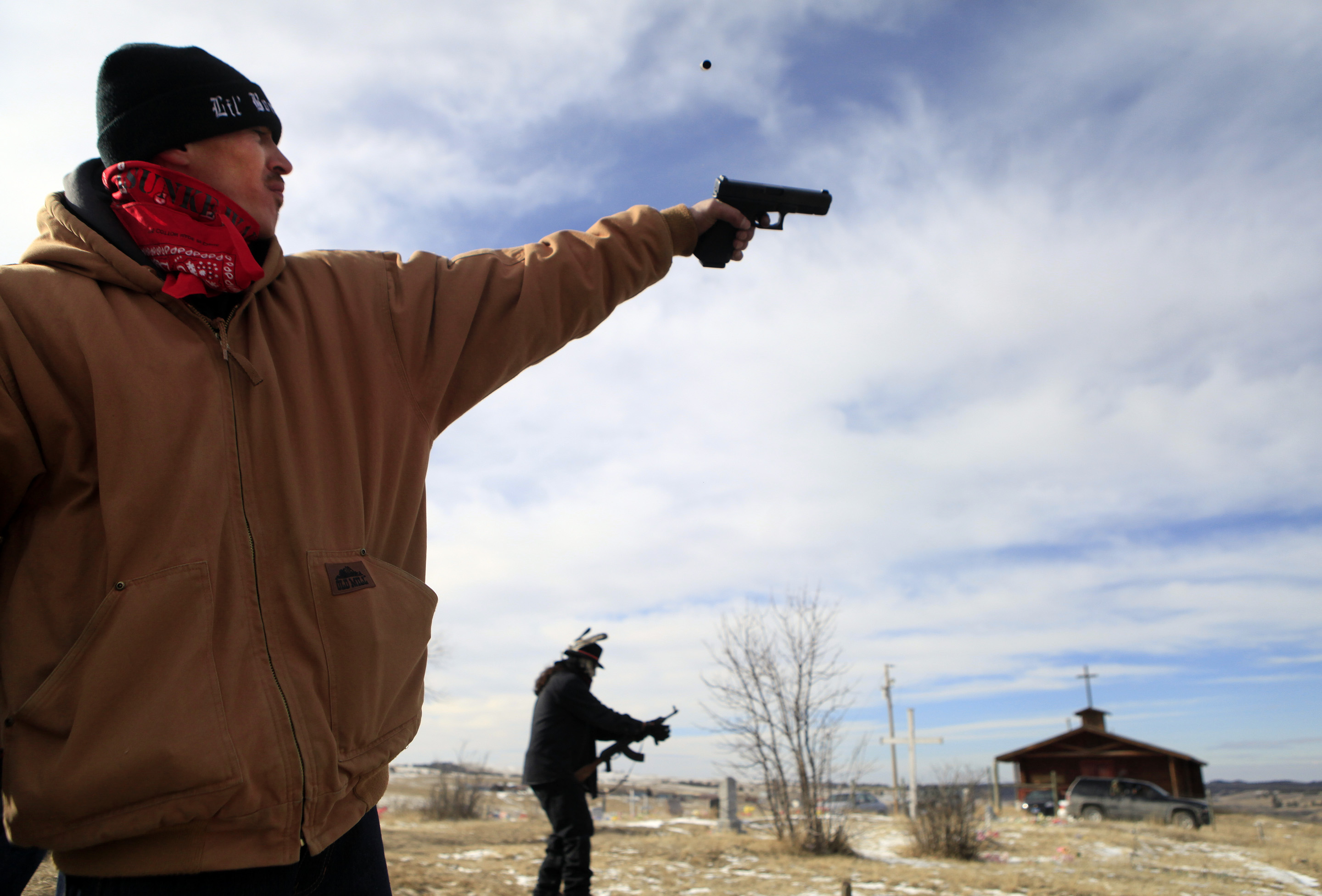 Kevin True Blood, 35, of Porcupine, S.D.,  shoots off his pistol in celebration of the Wounded Knee Liberation Anniversary on the Pine Ridge Indian Reservation, Feb. 27, 2014.