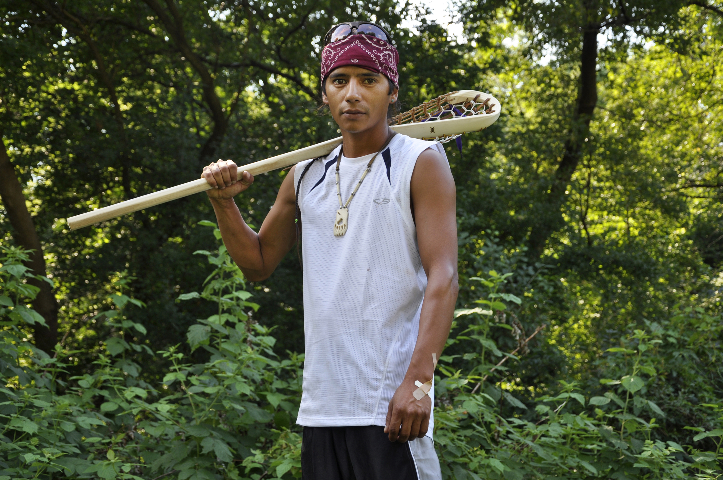 John Parsons holds a traditional lacrosse stick at the Onondaga Nation. Living uneasily among Americans, many Iroquois still believe they're fighting for their own identity, Onondaga Nation, N.Y., July 19, 2010.