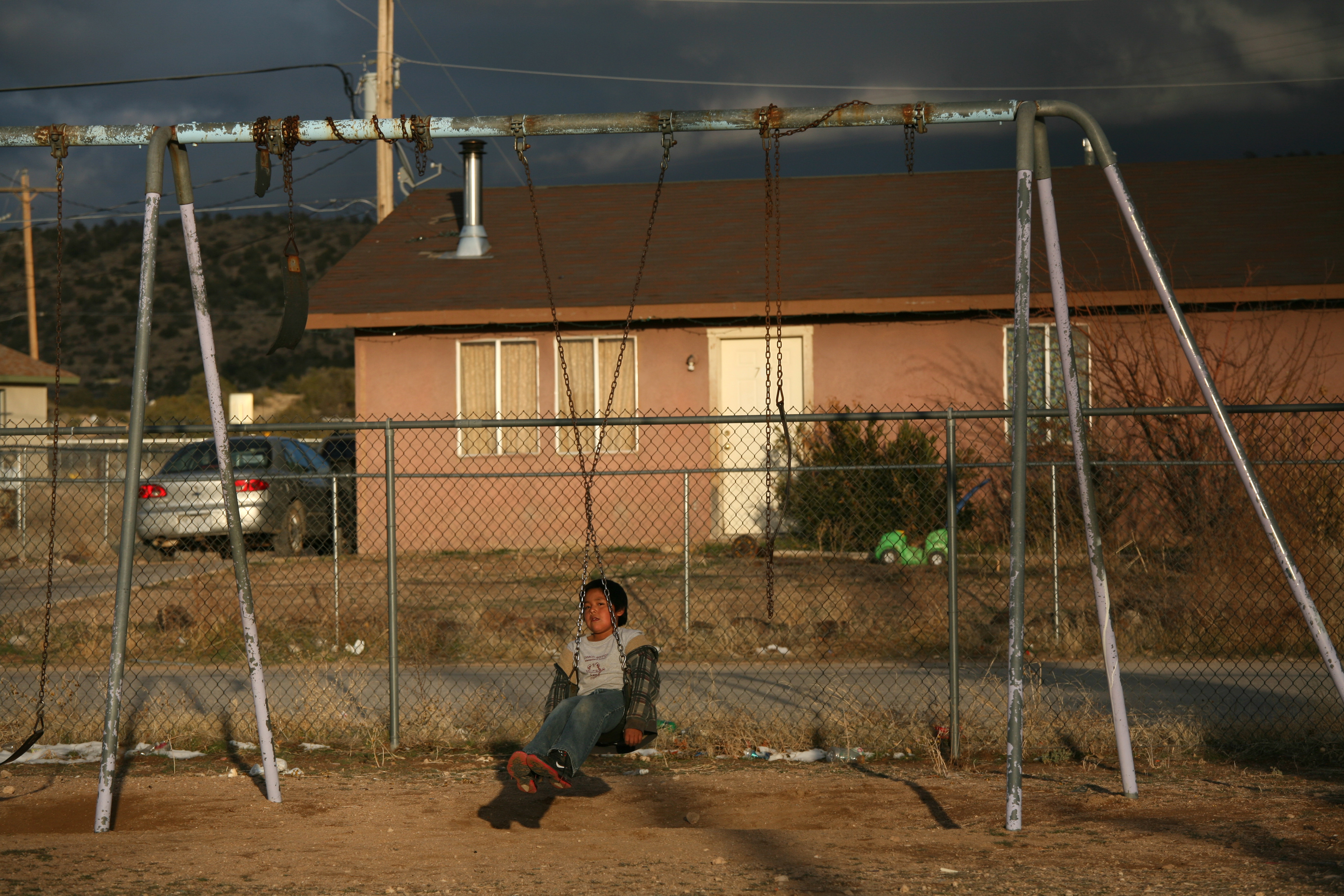 A young boy plays on a swing set in a park on the Hualapai Indian Reservation in Peach Springs, Ariz., Feb. 28, 2012.