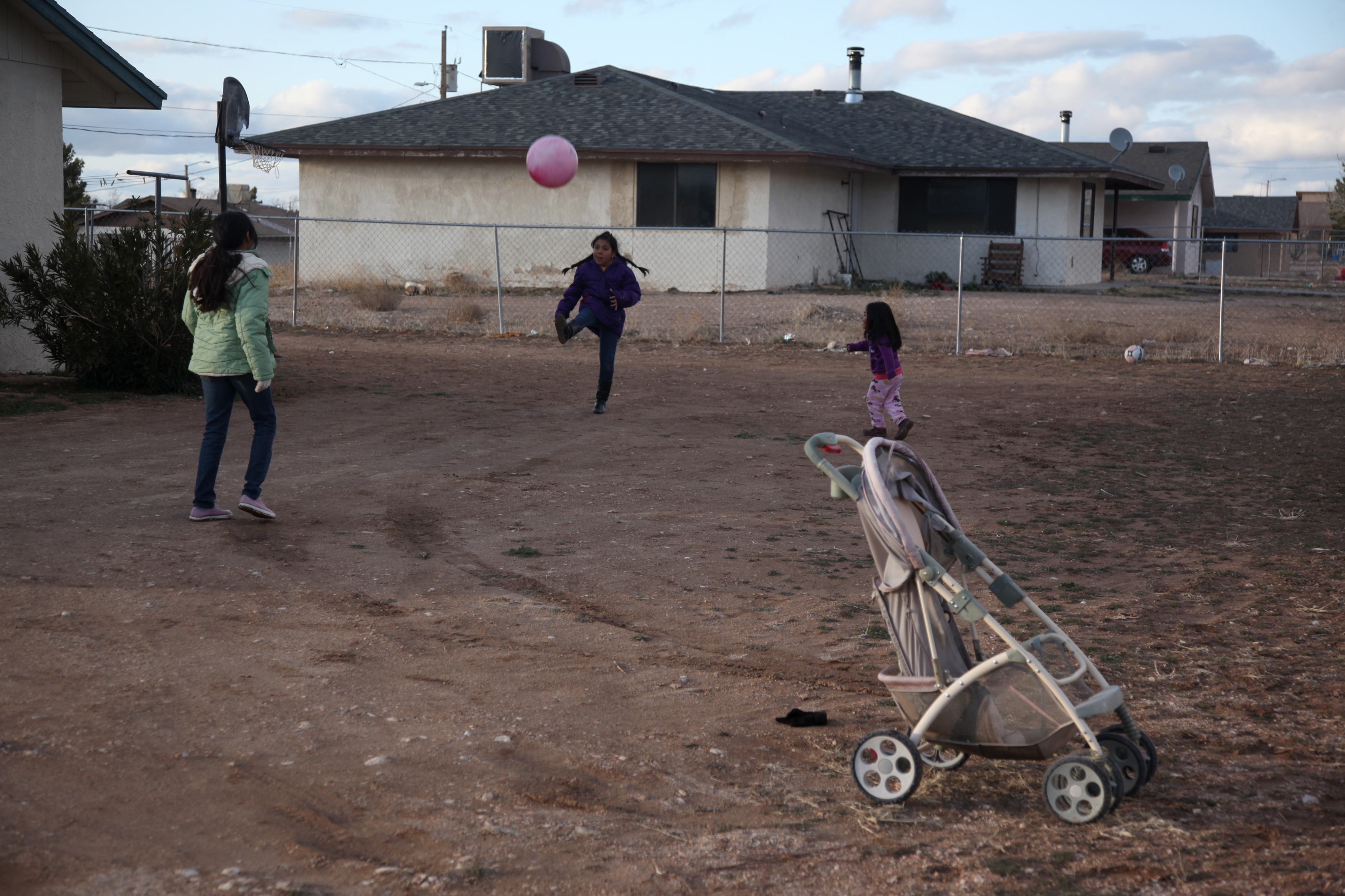 Children play in the yard of a home on the Hualapai Indian Reservation in Peach Springs, Ariz., Feb. 28, 2012.