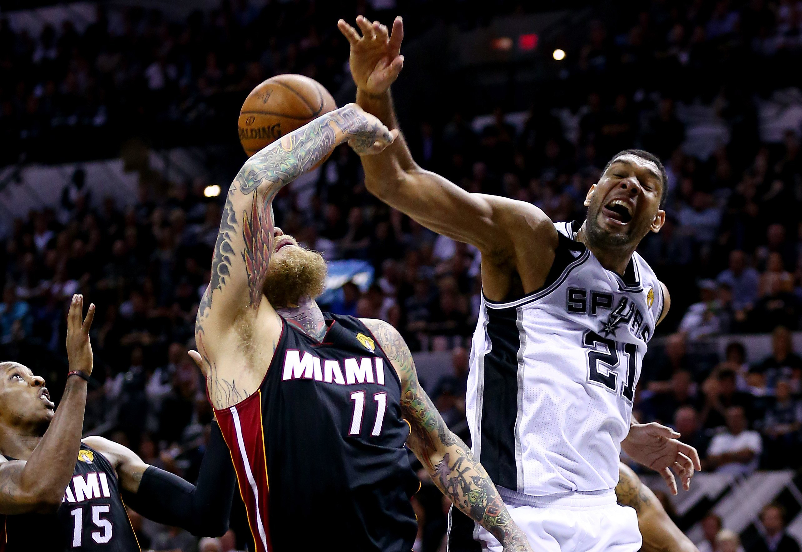 Tim Duncan #21 of the San Antonio Spurs battles for a rebound against Chris Andersen #11 of the Miami Heat during Game 2 of the 2014 NBA Finals in San Antonio on June 8, 2014.