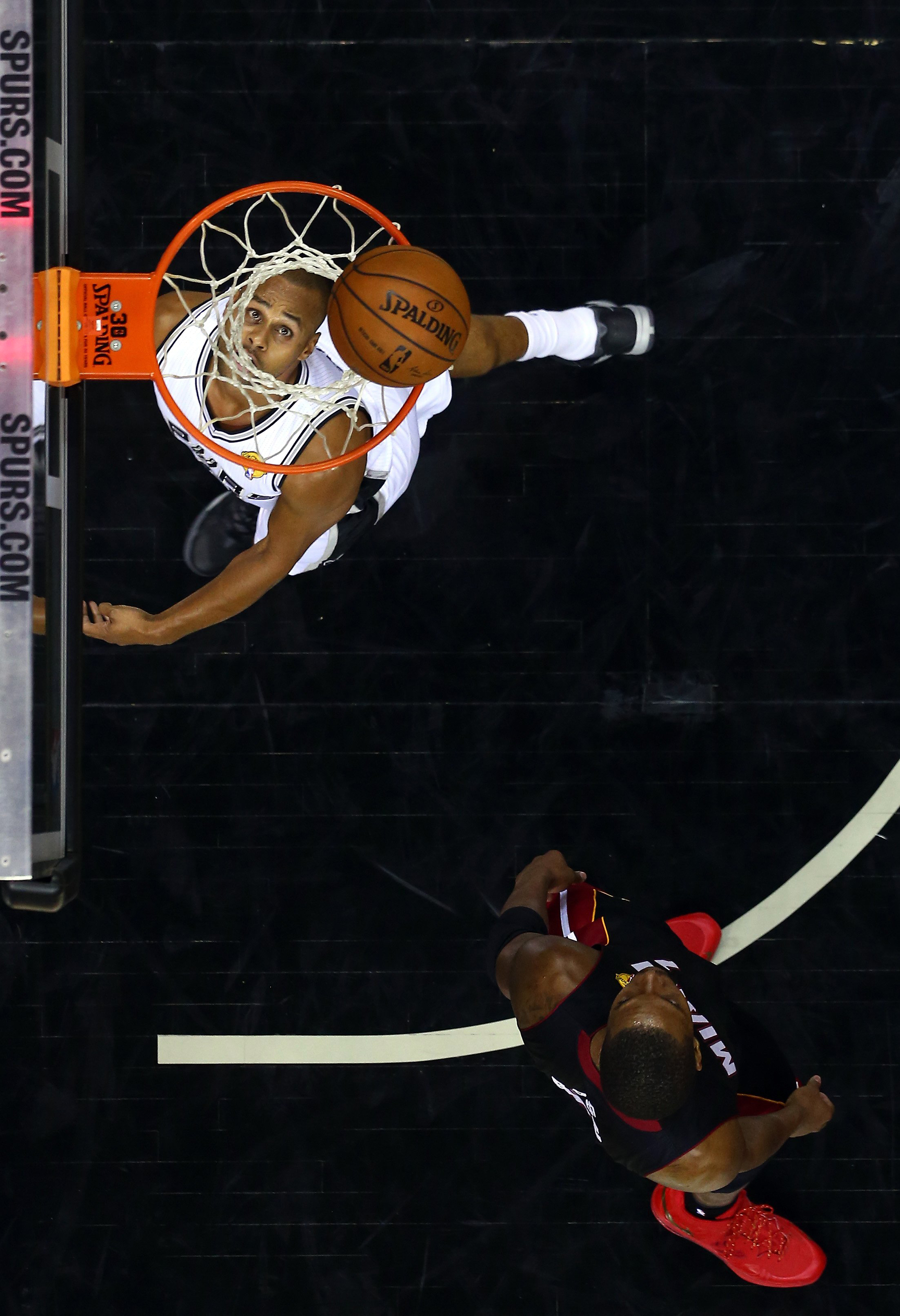 Patty Mills #8 of the San Antonio Spurs goes to the basket against the Miami Heat during Game 2 of the 2014 NBA Finals in San Antonio on June 8, 2014.