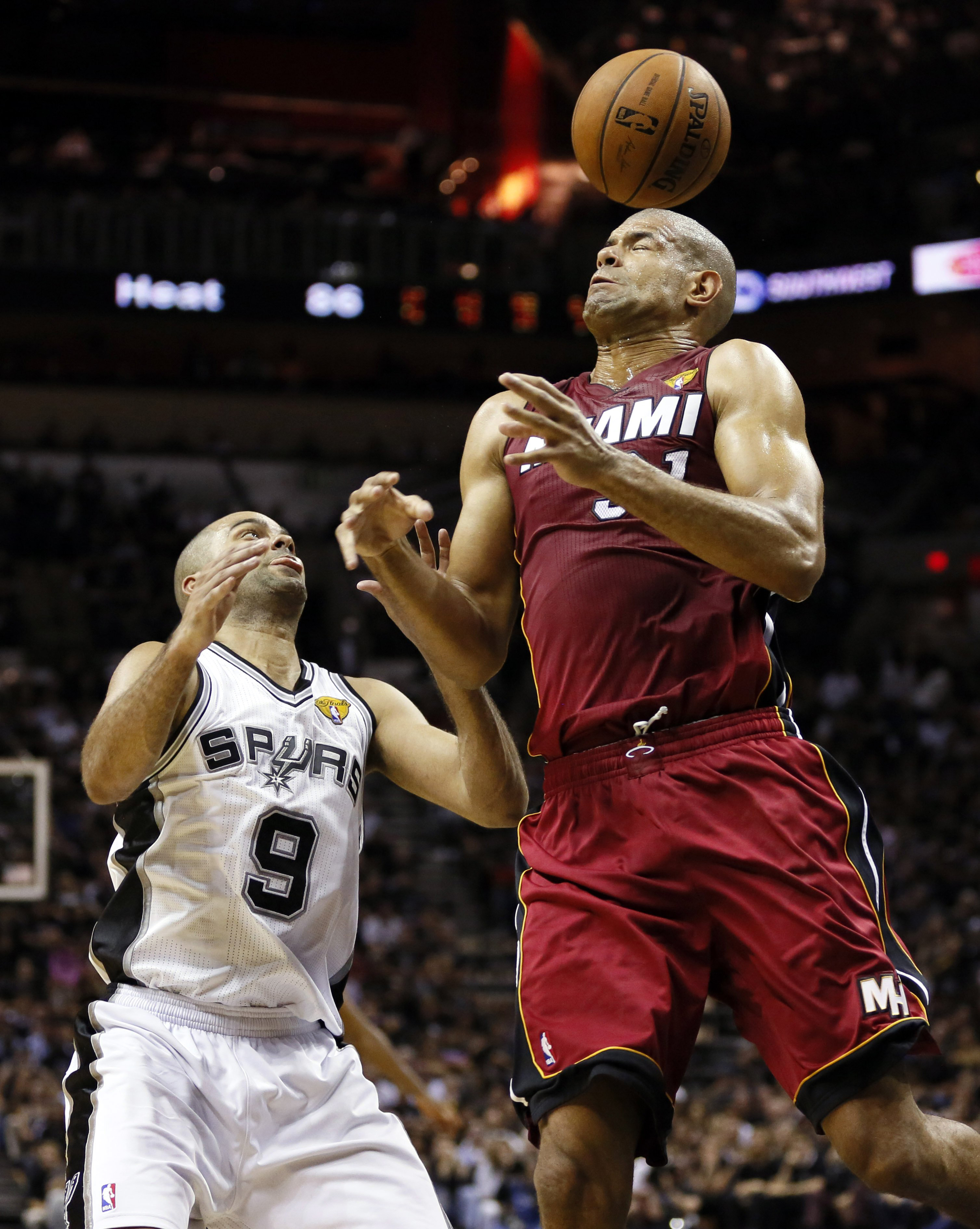 San Antonio Spurs guard Tony Parker (9) and Miami Heat guard Ray Allen (34) go for a loose ball during the fourth quarter in Game 1 of the 2014 NBA Finals in San Antonio on June 5, 2014.