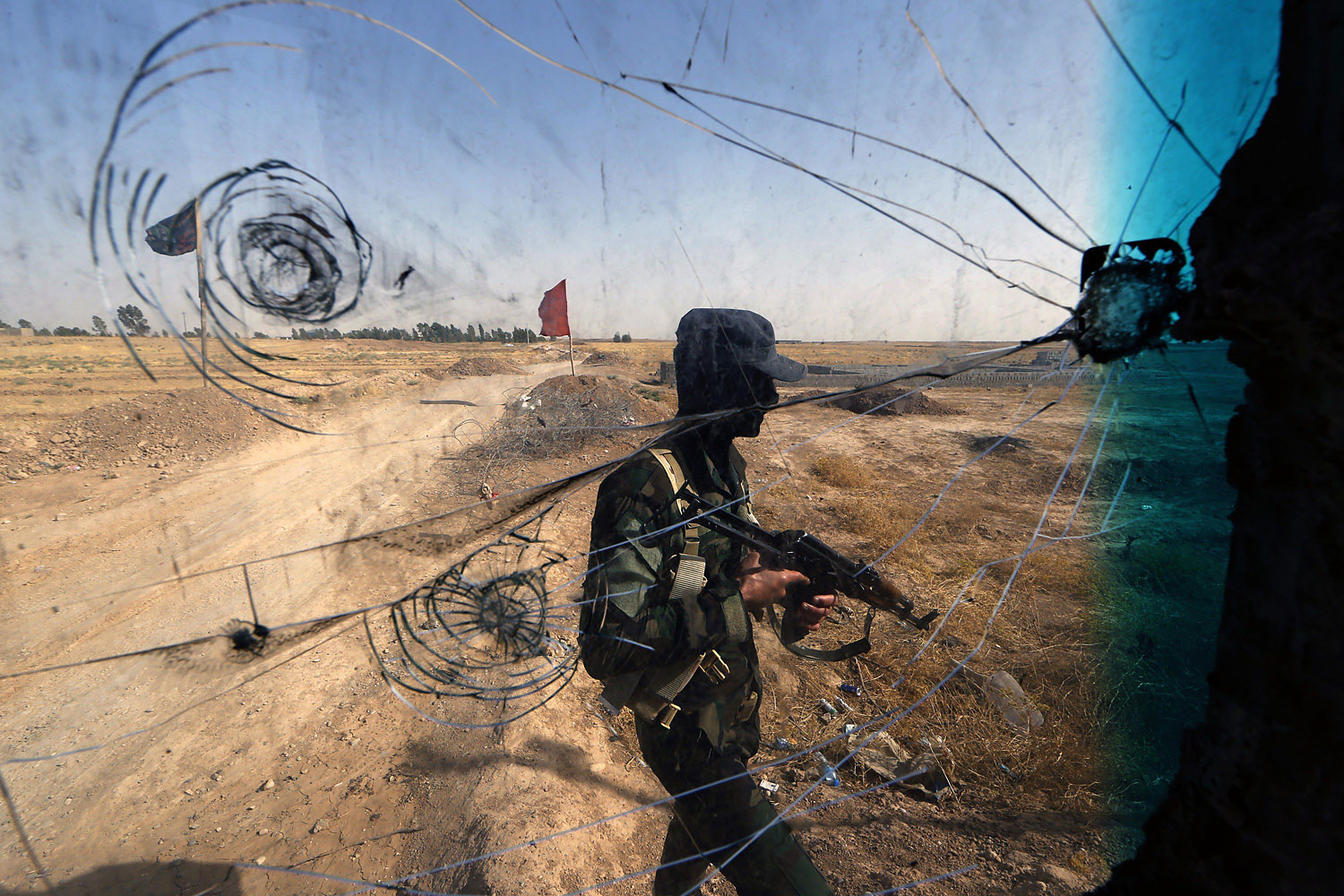 Iraqi Turkmen forces patrol a checkpoint on June 21, 2014, close to locations of jihadist Islamic State of Iraq and Syria (ISIS) fighters.