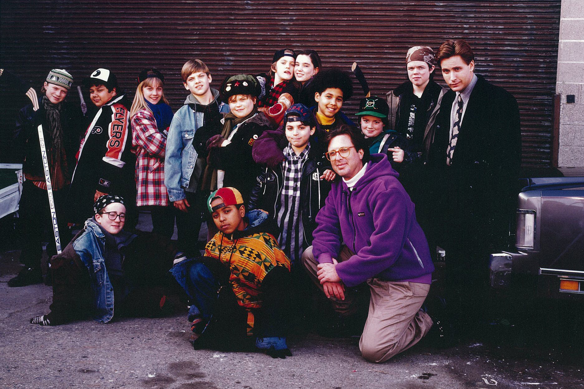 The cast of the first 'Mighty Ducks' films with producer Jordan Kerner (kneeling).