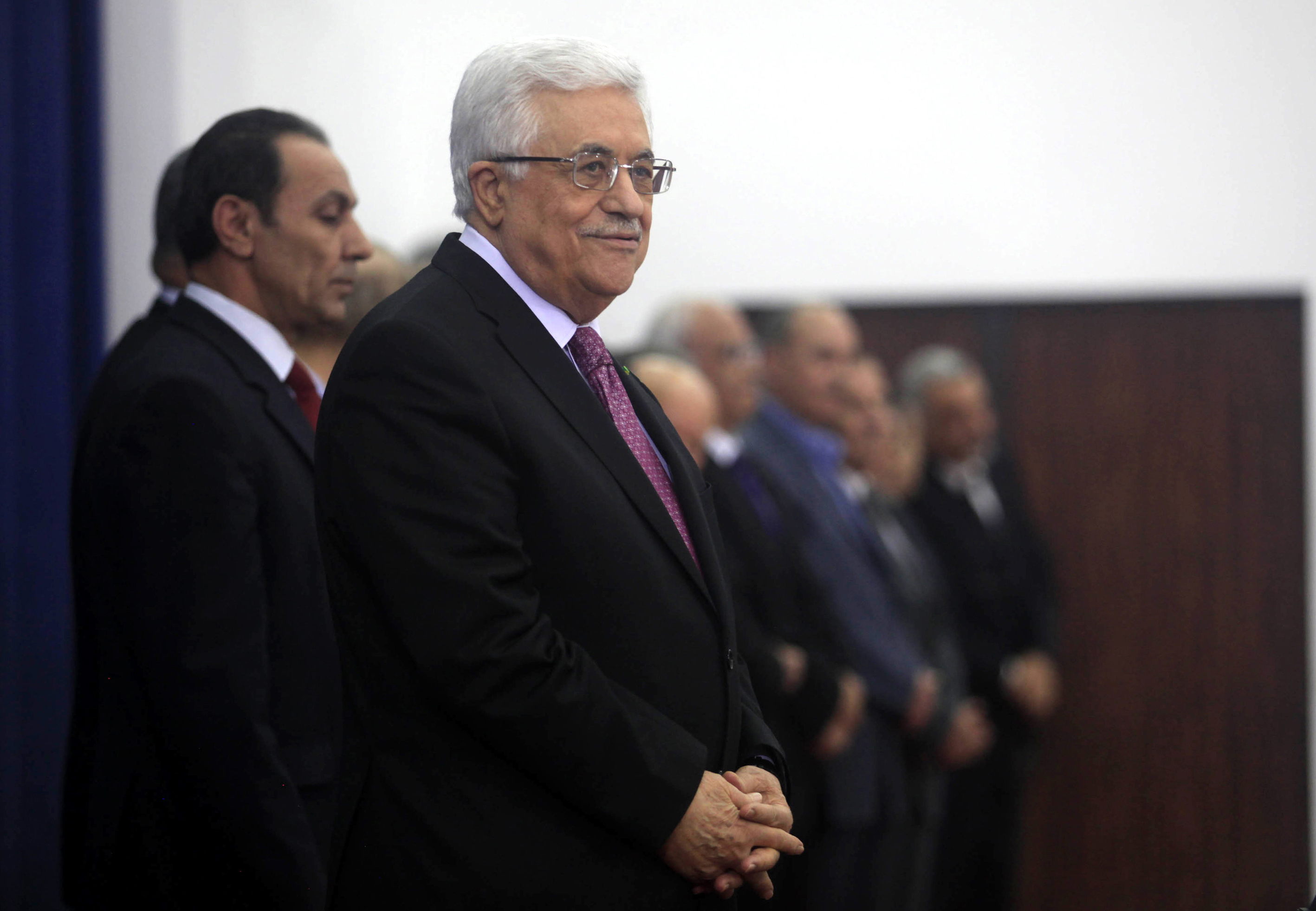 Palestinian President Mahmoud Abbas attends the swearing-in ceremony with the new unity government  in the West Bank town of Ramallah on June 02, 2014.