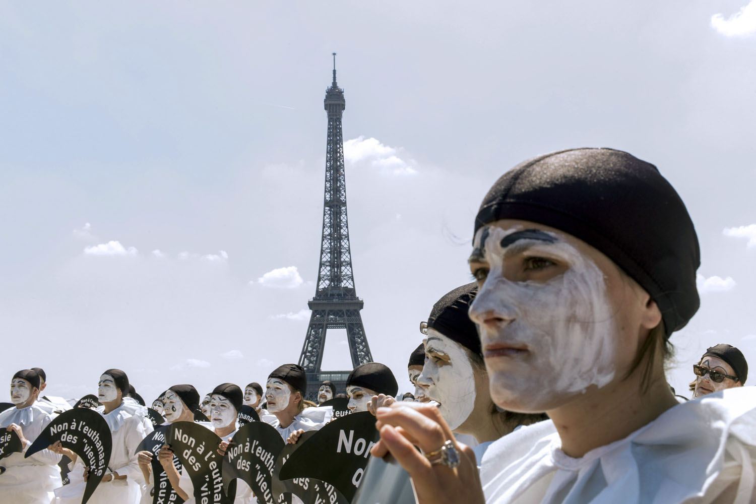 Jun. 24, 2014. People dressed as the traditionnal theatre character  Pierrot  hold placards reading  No to euthansia of  old people   as they take part in a demonstration against euthanasia for elderly and dependent people on the Trocadero esplanade, also called the Parvis of Human Rights, near the Eiffel Tower in Paris.