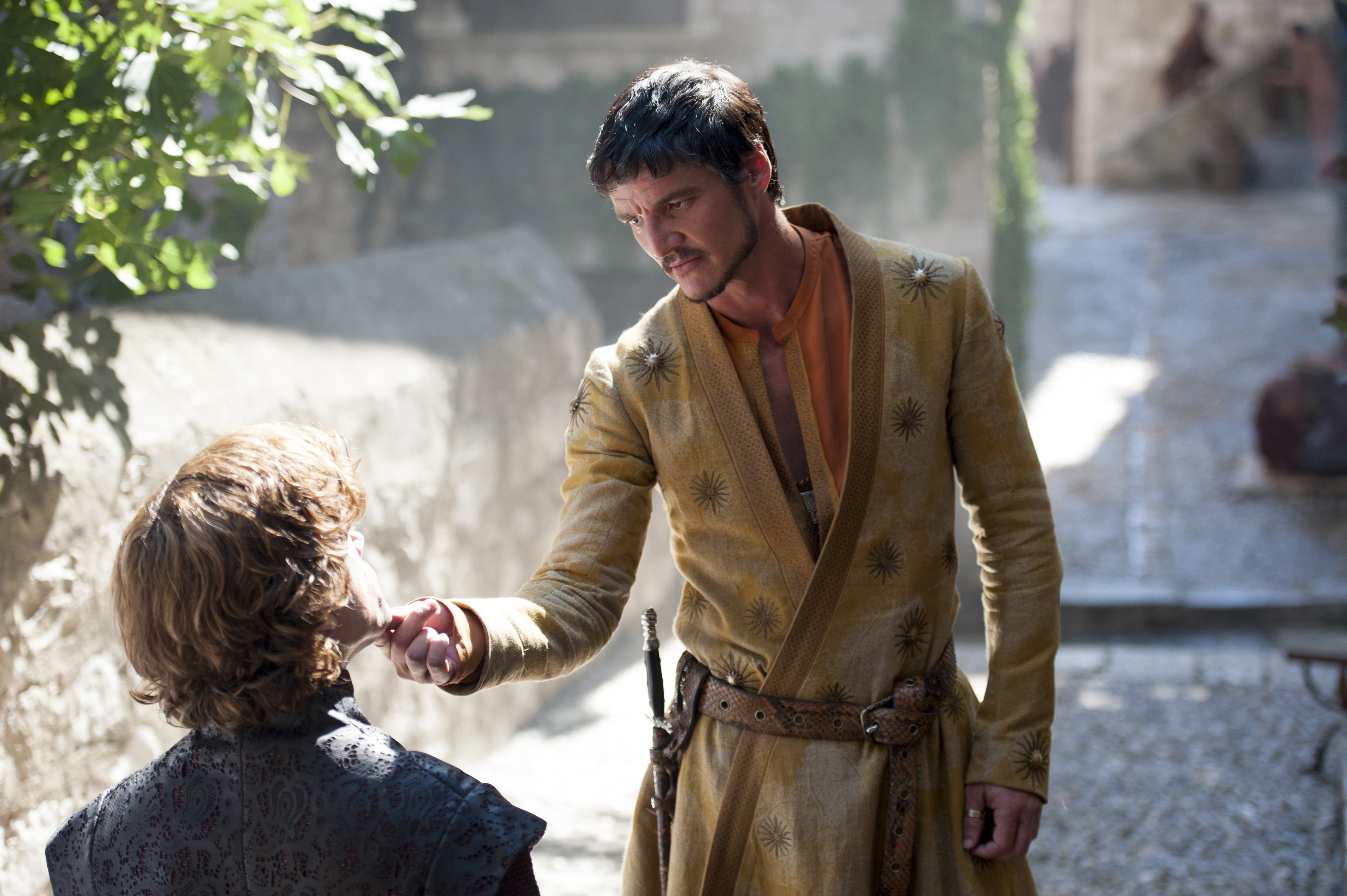 Oberyn Martell (Pedro Pascal) shares a moment with Tyrion (Peter Dinklage).