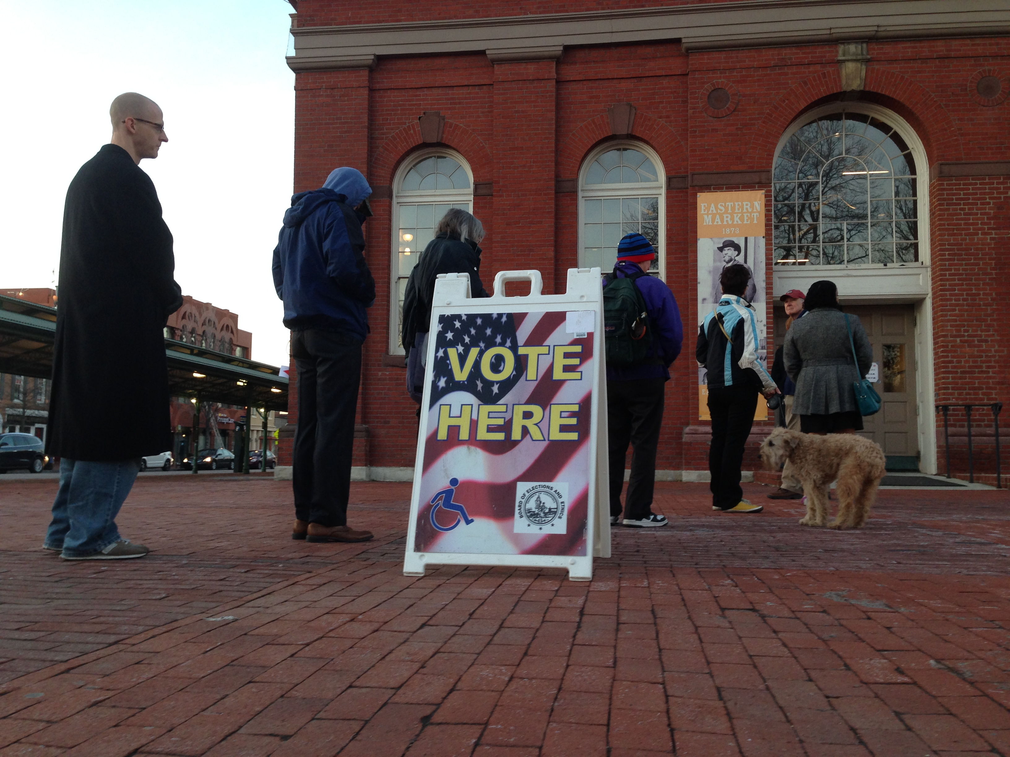 Democratic voters wait in line at the Eastern Market polling place to vote in the Democratic primary for the District's mayor race in Washington, April 1, 2014.