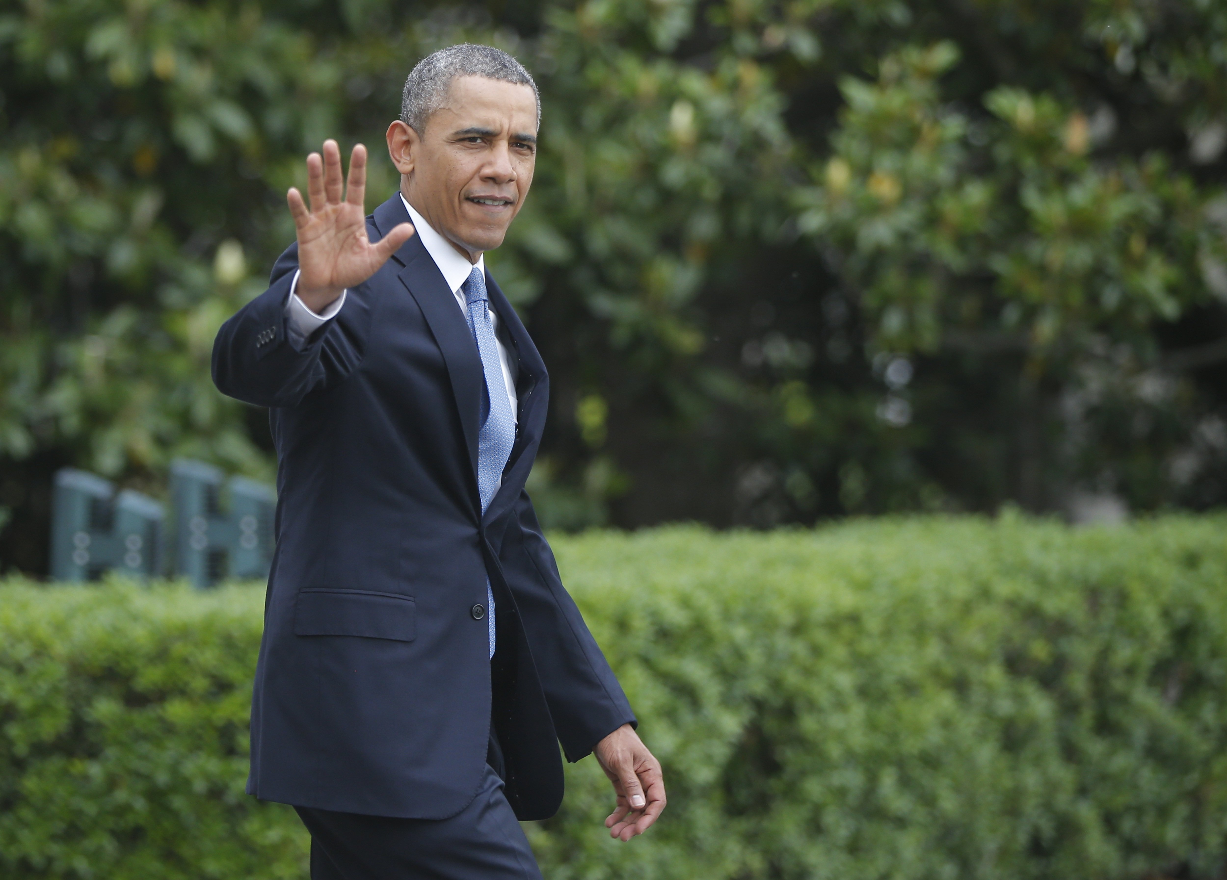 President Barack Obama walks on the South Lawn of the White House in Washington to board Marine One helicopter, Wednesday, May 28, 2014, as he travels to deliver the commencement address at the United States Military Academy at West Point.
