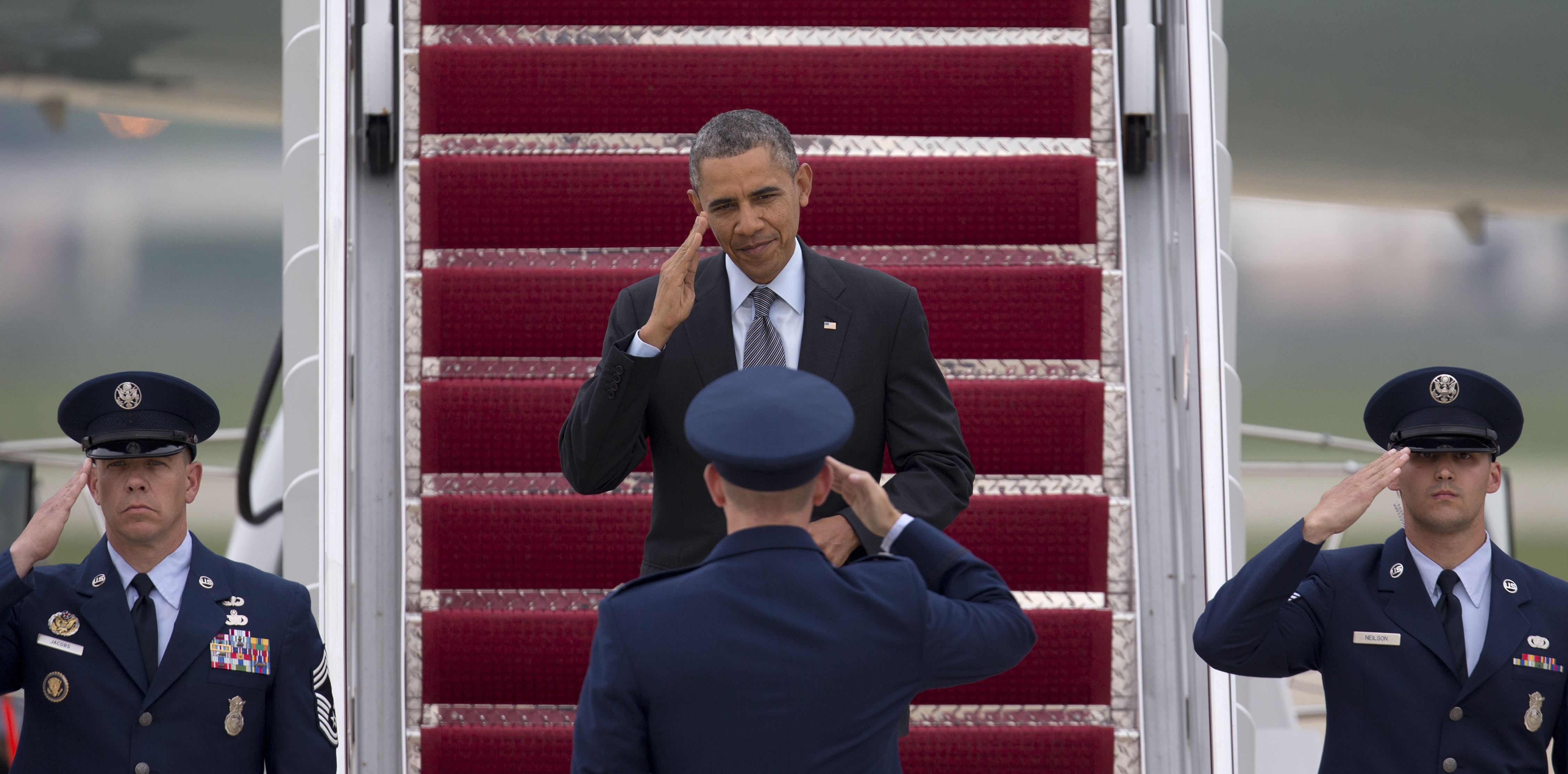 President Barack Obama returns a salute from Col. William M. Knight as he steps off of Air Force One in Andrews Air Force Base, Md, May 9, 2014.