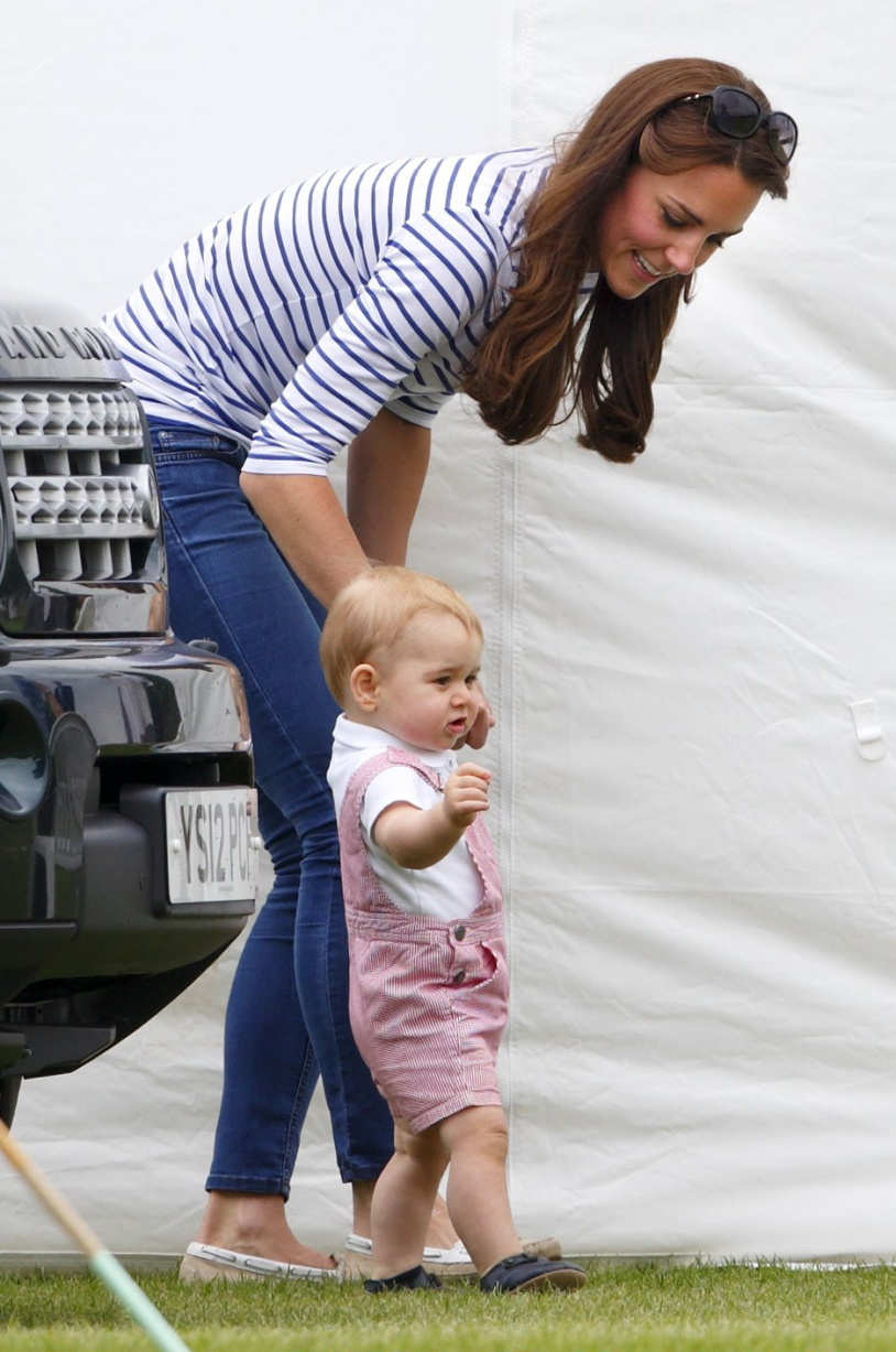 <strong>Walking and Talking</strong>Prince George of Cambridge walks holding his mother Catherine, Duchess of Cambridge's hand as they watch Prince William, Duke of Cambridge and Prince Harry play in the Jerudong Trophy charity polo match at Cirencester Park Polo Club on June 15, 2014 in Cirencester, England.