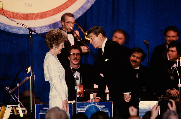 Always the Gentleman  I always felt the President had old-fashioned manners, as in this photo, where he leans over to ask his First Lady to dance at one of the balls held in their honor during the 1985 Inauguration.