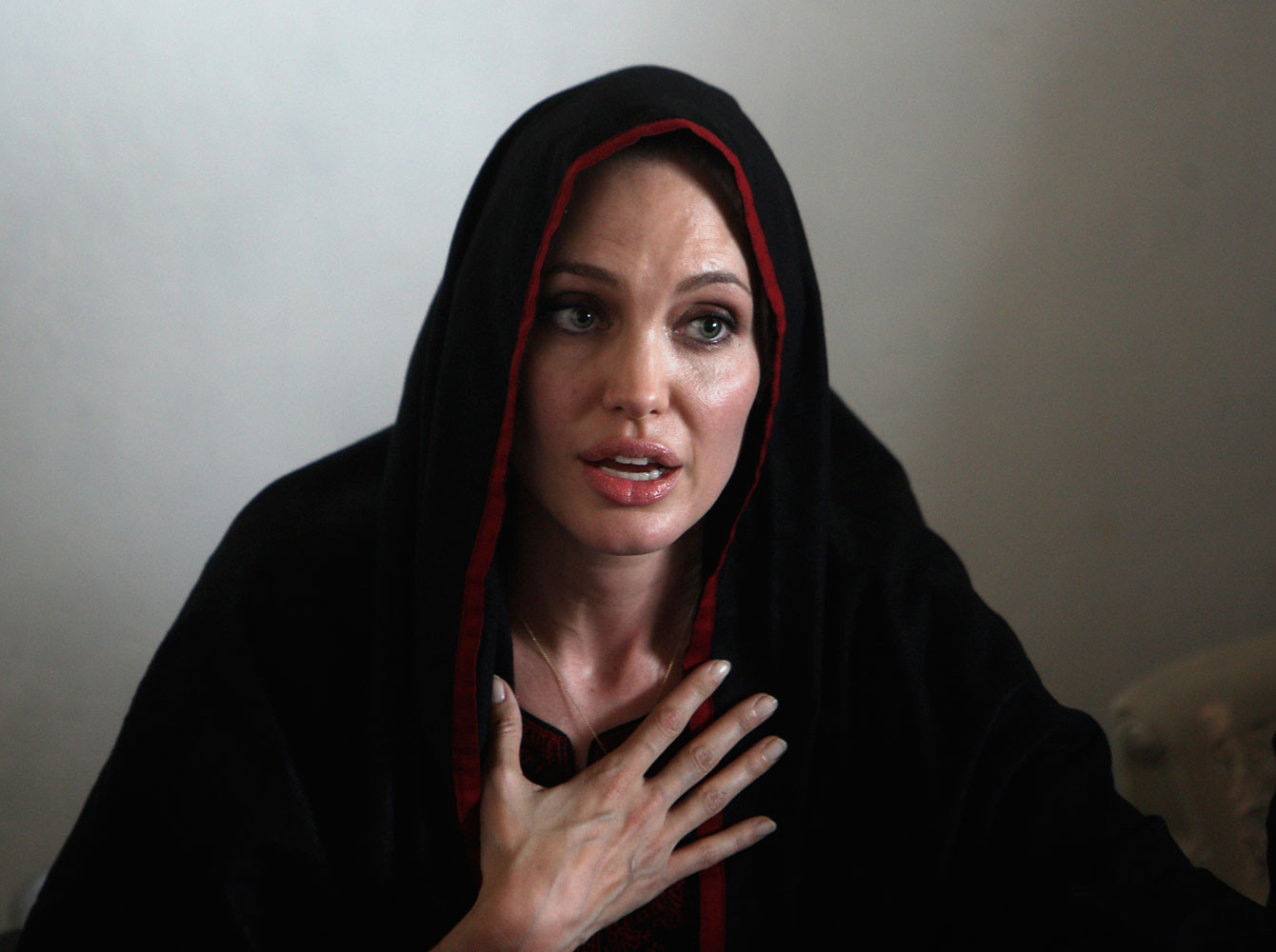 Angelina Jolie  speaks with media during a visit to the Jalozai flood victim relief camp in Pakistan's northwest Khyber-Pakhtunkhwa province on Sept. 7, 2010.