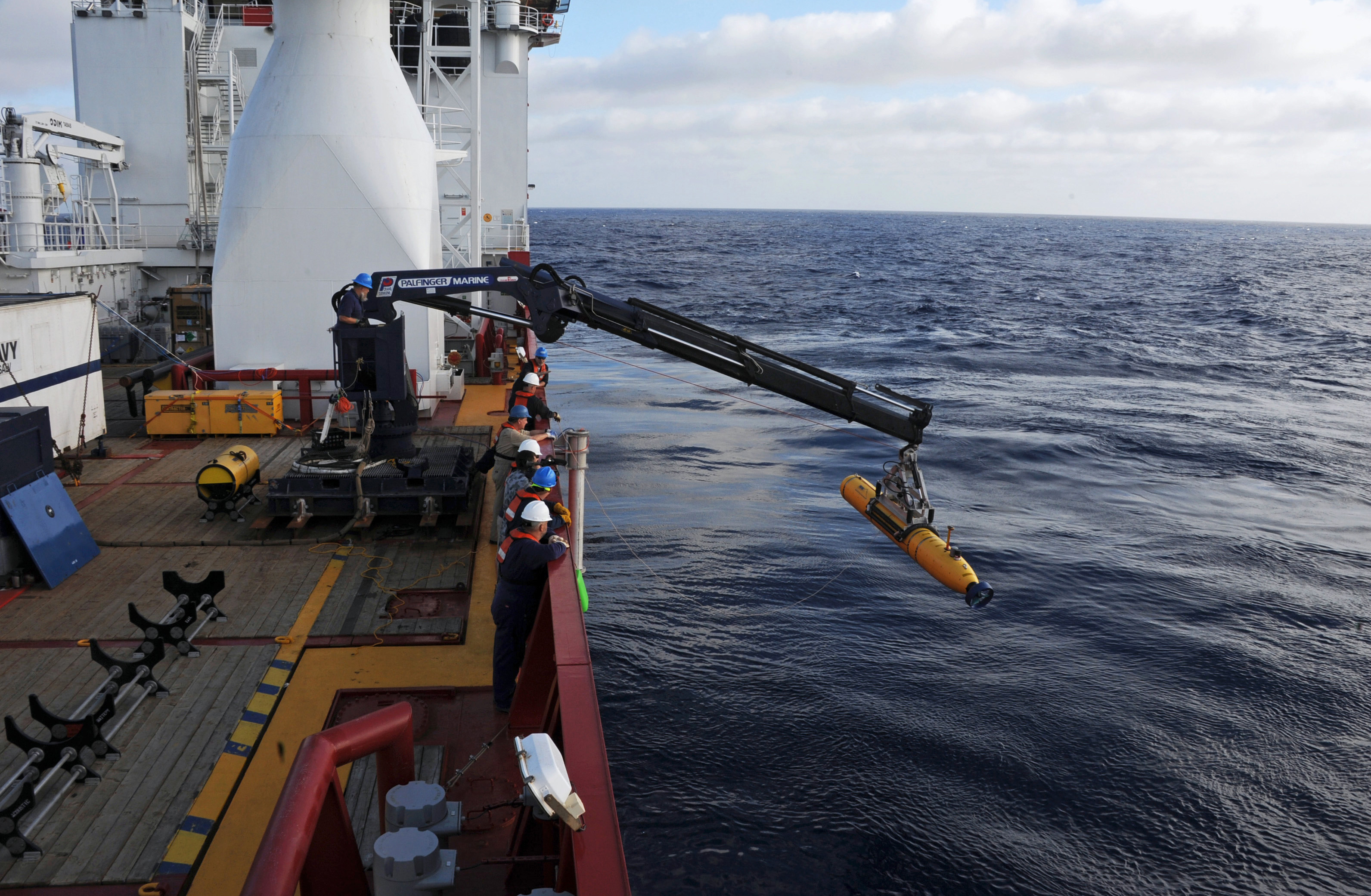 Crew aboard the Australian Defence Vessel Ocean Shield move the U.S. Navy's Bluefin-21 autonomous underwater vehicle into position for deployment in the southern Indian Ocean to look for the missing Malaysia Airlines flight MH370, April 14, 2014 in this handout picture released by the U.S. Navy.
