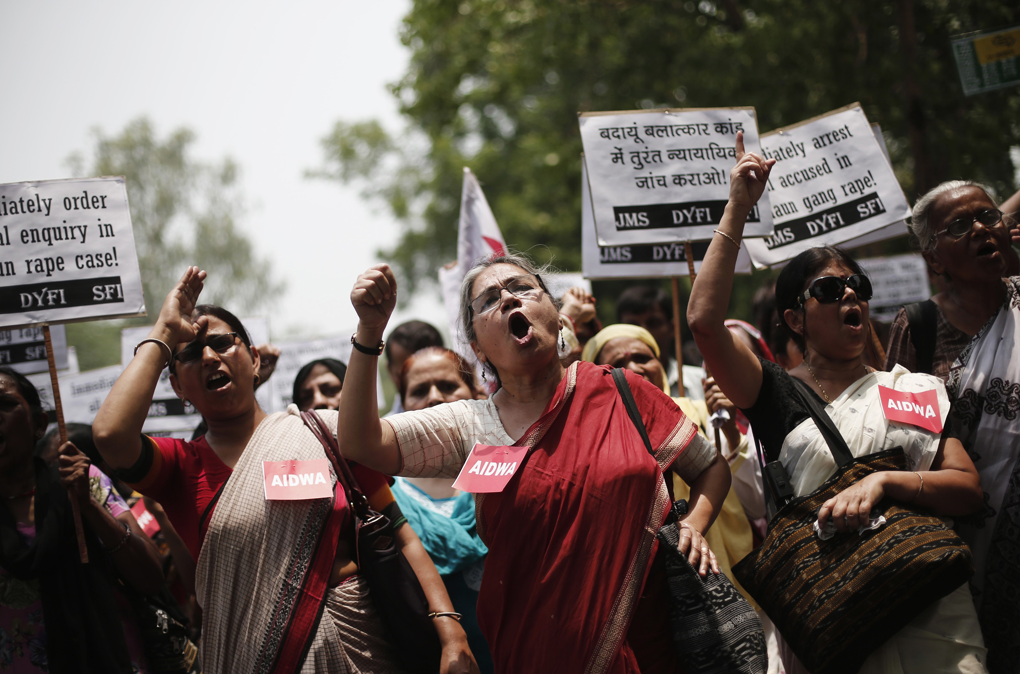 Demonstrators from All India Democratic Women's Association hold placards and shout slogans during a protest against the recent rape and hanging of two teenage girls, in New Delhi, May 31, 2014.