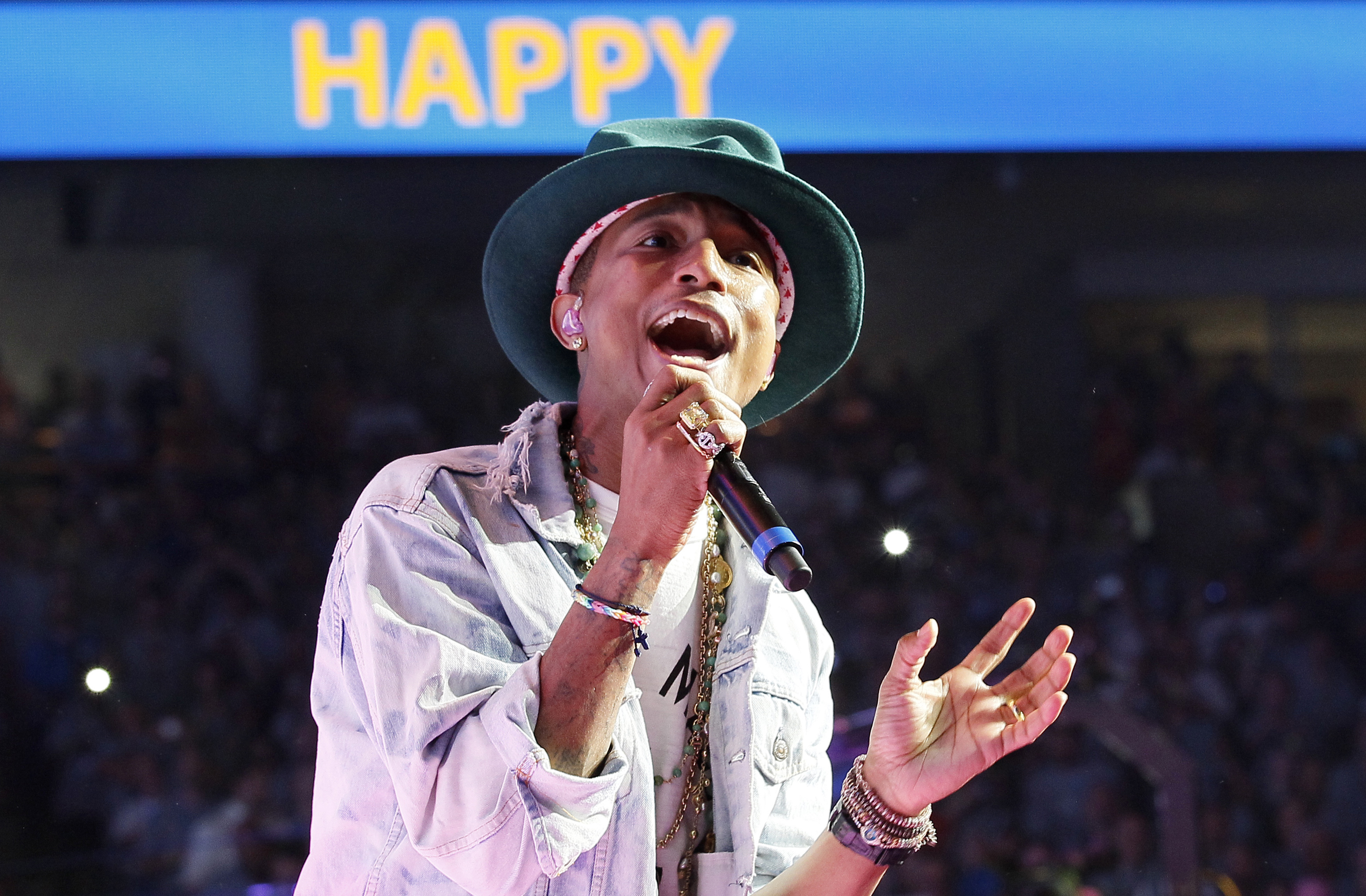 Singer Pharrell Williams performs his hit song  Happy  at the Walmart annual shareholders meeting in Fayetteville, Arkansas June 6, 2014.