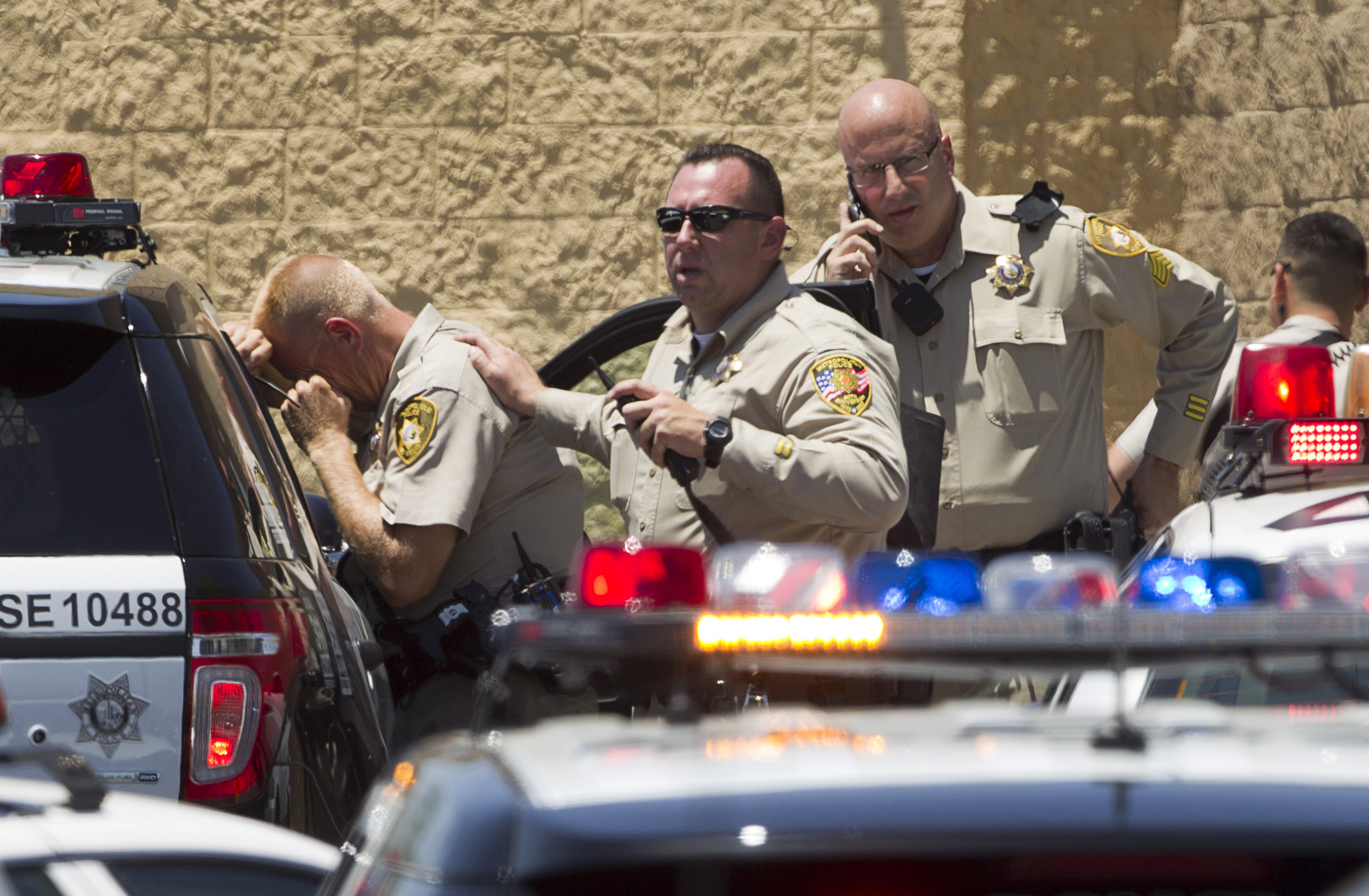 Metro Police officers are shown outside a Wal-Mart after a shooting in Las Vegas June 8, 2014.