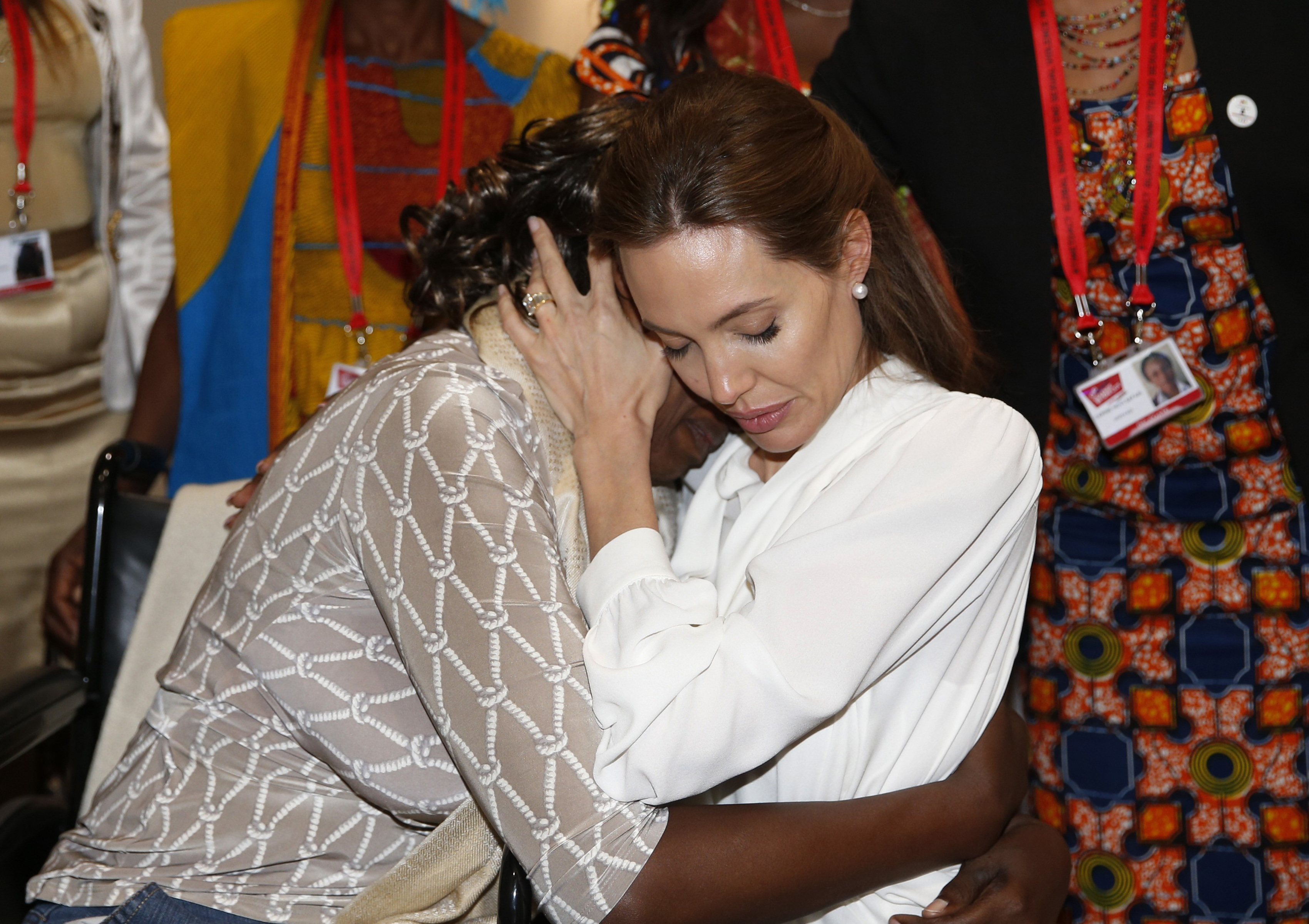 Actress and Special Envoy of the United Nations High Commissioner for Refugees, Angelina Jolie, hugs Neema Namadamu of the Democratic Republic of Congo a the 'End Sexual Violence in Conflict' summit in London June 11, 2014.