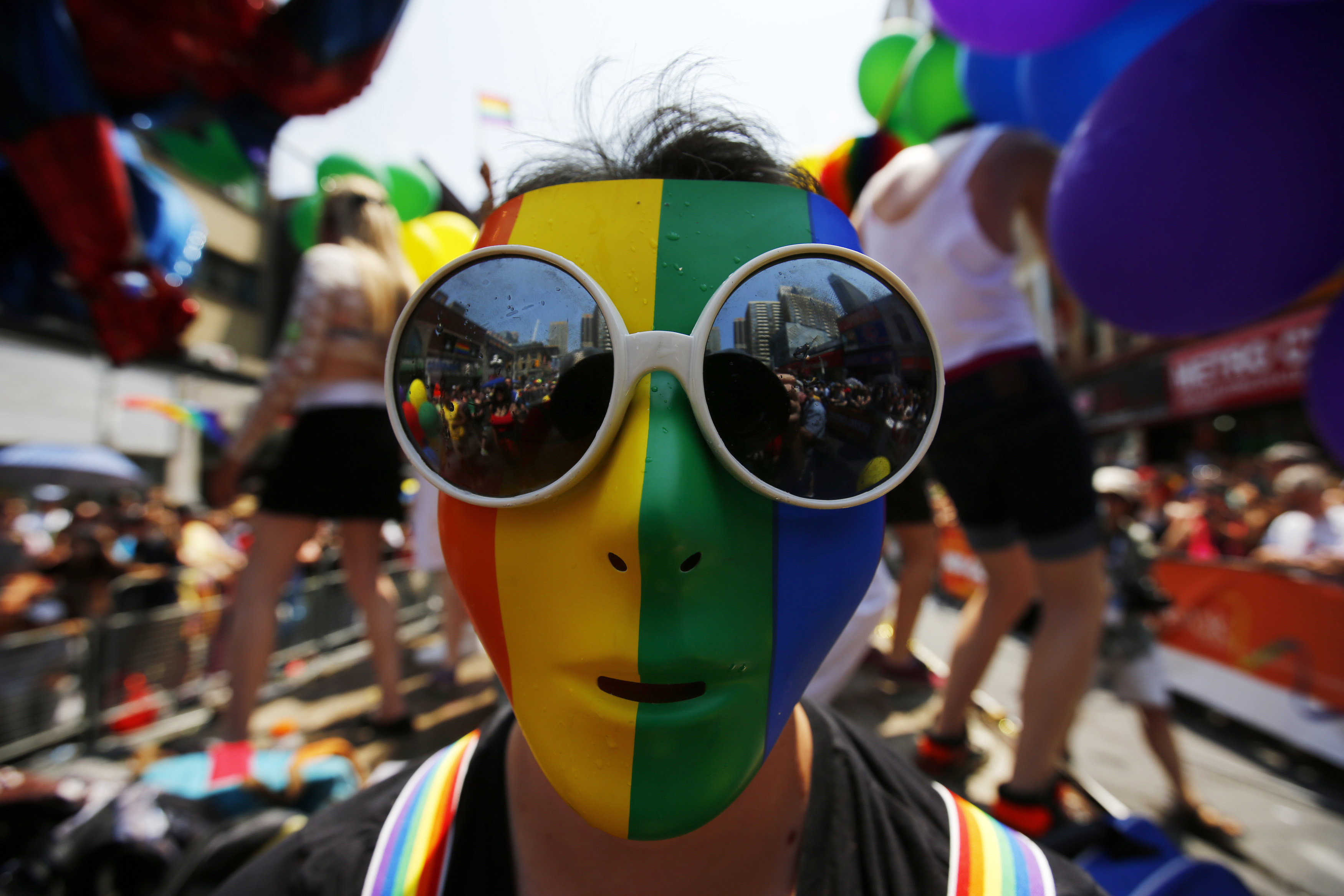 A man wearing a rainbow mask is seen during the  WorldPride  gay pride Parade in Toronto, Canada, June 29, 2014.